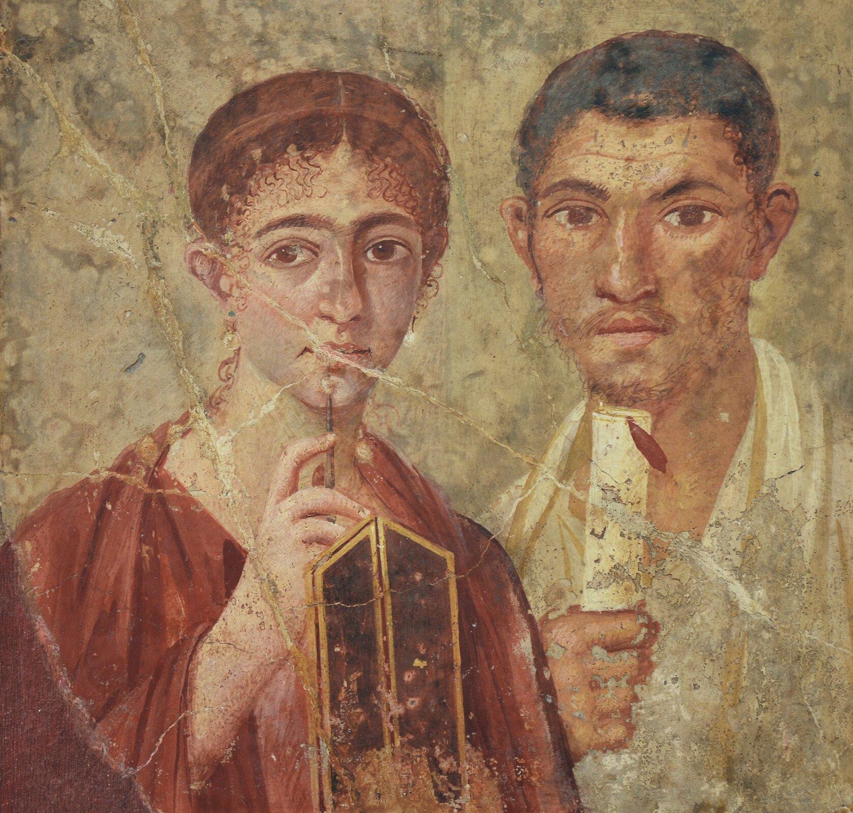 Freski zPompejów ukazujące postaci zwoskowymi tabliczkami izwojem papirusu Freski zPompejów ukazujące postaci zwoskowymi tabliczkami izwojem papirusu Źródło: Carole Raddato, Naples National Archaeological Museum, licencja: CC BY-SA 2.0.