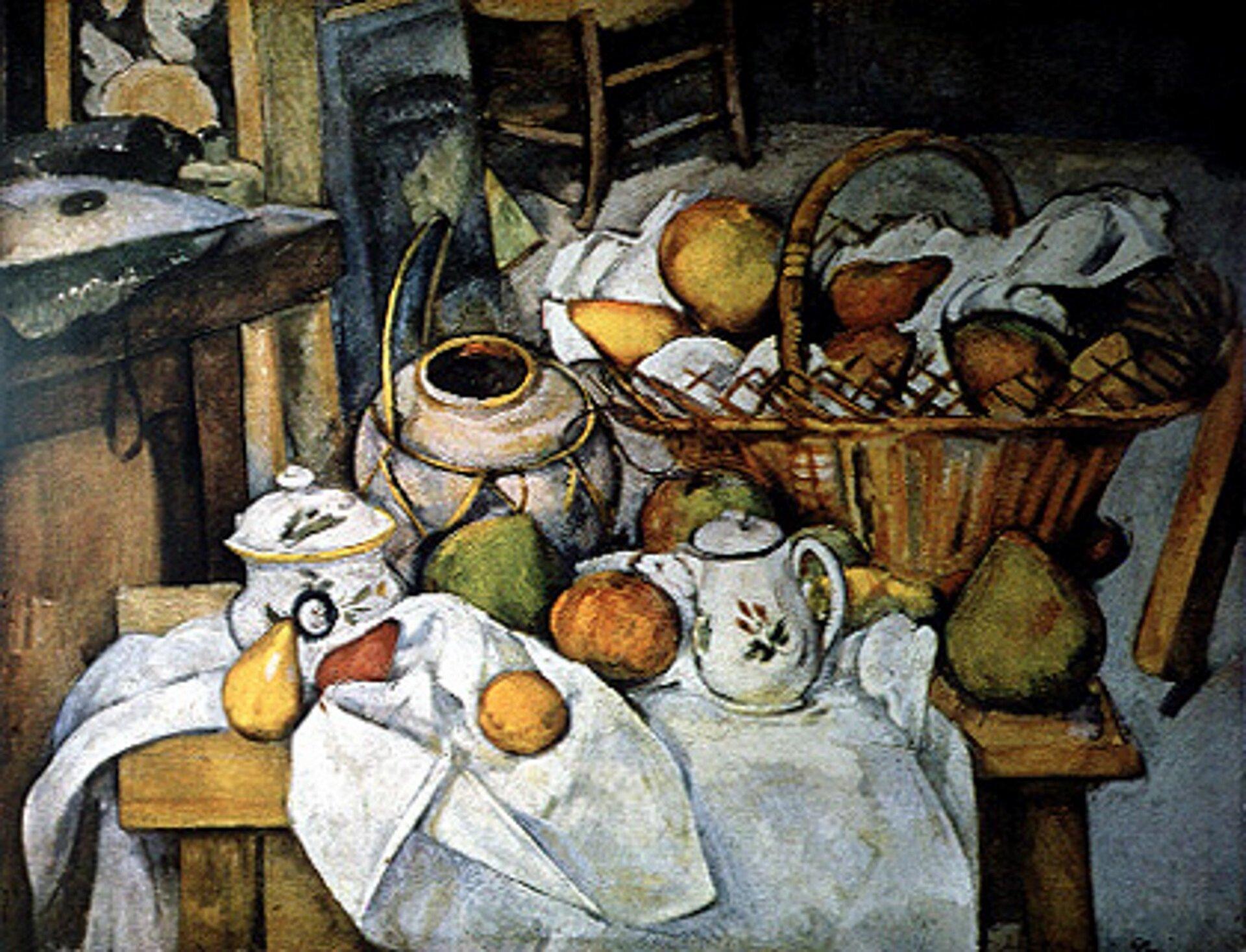 """Ilustracja przedstawia obraz Paula Cézanne pt. """"Kuchenny stół"""". Dzieło powstało wlatach 1888-1890. Na obrazie został przedstawiony stół zjasnym nakryciem. Ustawione są na nim naczynia oraz kosz zapełniony owocami. Widzimy także pojedyncze owoce: gruszki, jabłka. Ulubioną tematyką artysty były pejzaże, portrety, atakże martwa natura. Cézanne zajmował się głównie malowaniem owoców, stołów, krzeseł przedstawiając je wspecyficzny sposób."""