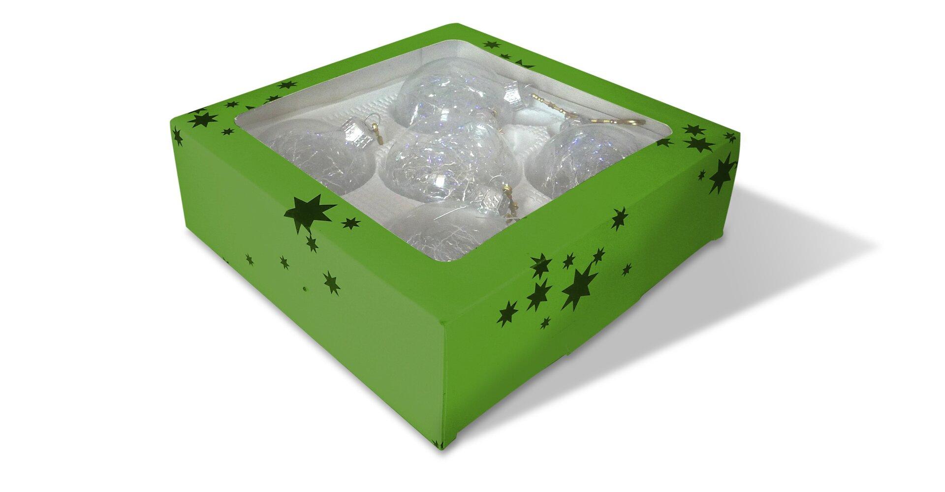 Rysunek pudełka zbombkami choinkowymi.