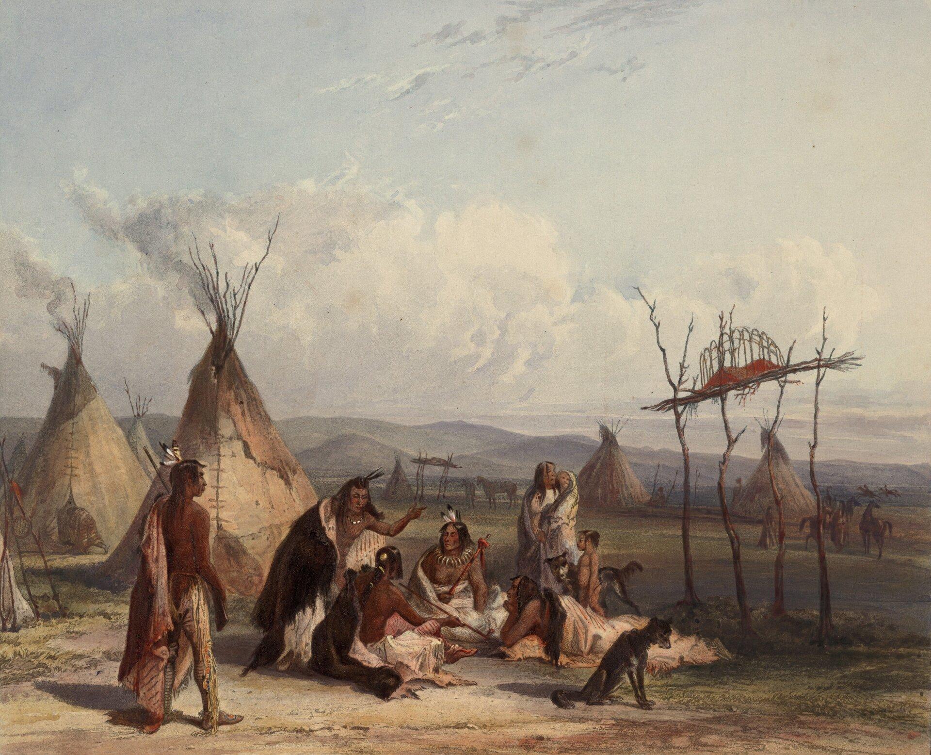 Na obrazie grupa Indian siedzi na ziemi, wtle kilka tipi, obok rusztowanie pogrzebowe zczterech gałęzi.