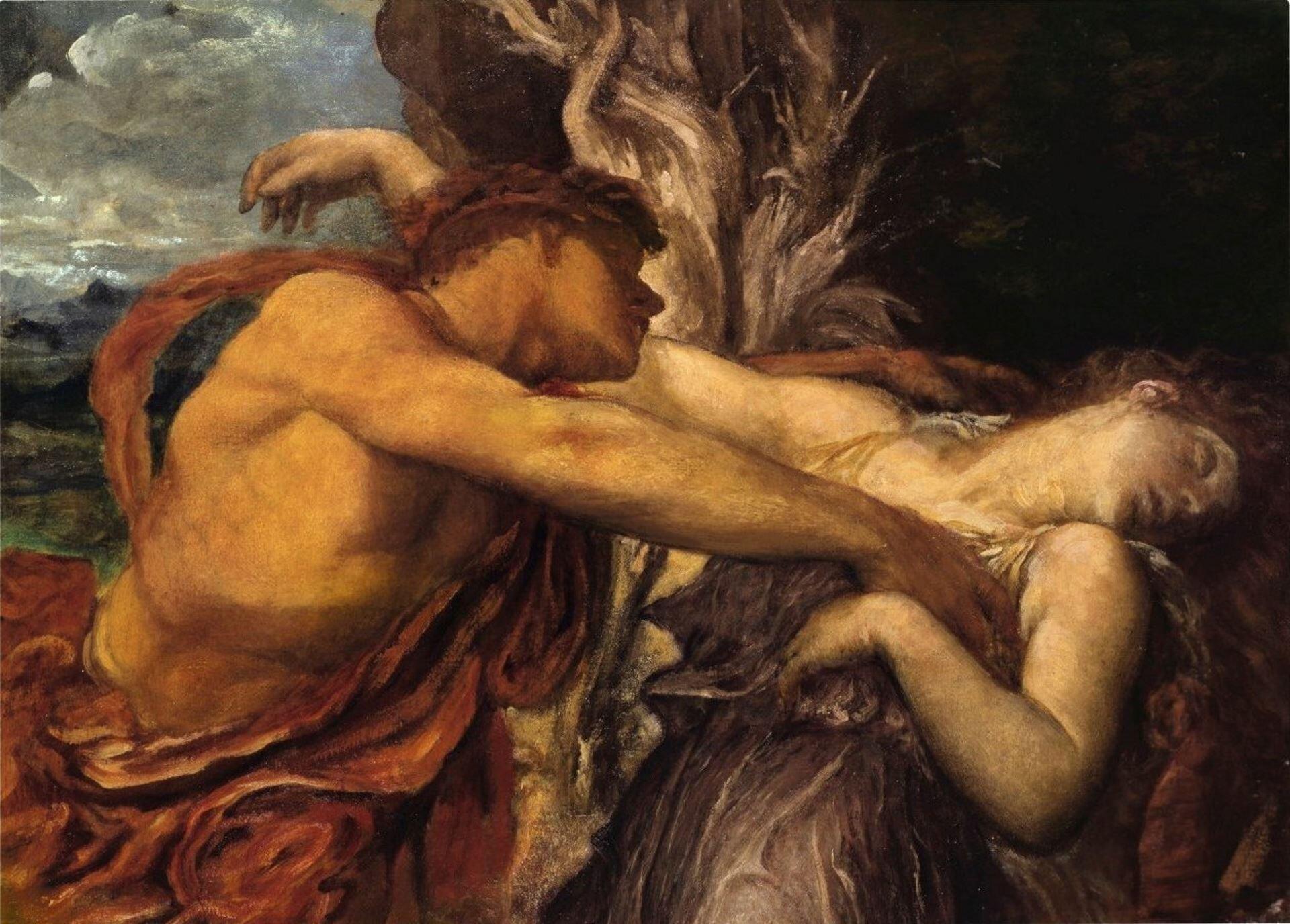 """lustracja przedstawia obraz Georgea Fredericka Watts'a pt. """"Orfeusz iEurydyka"""". Na pierwszym planie widnieją objęte postaci, ukazane od pasa wgórę. Tło obrazu jest ciemne; wlewym górnym rogu widnieje fragment zachmurzonego nieba. Orfeusz, spowity wczerwoną szatę, trzyma wwyciągniętych ramionach umierającą Eurydykę. Kobieta ma głowę odchyloną do tyłu, zamknięte oczy. Długie rude włosy opadają jej na plecy. Prawą rękę ma zarzuconą na ramię Orfeusza."""