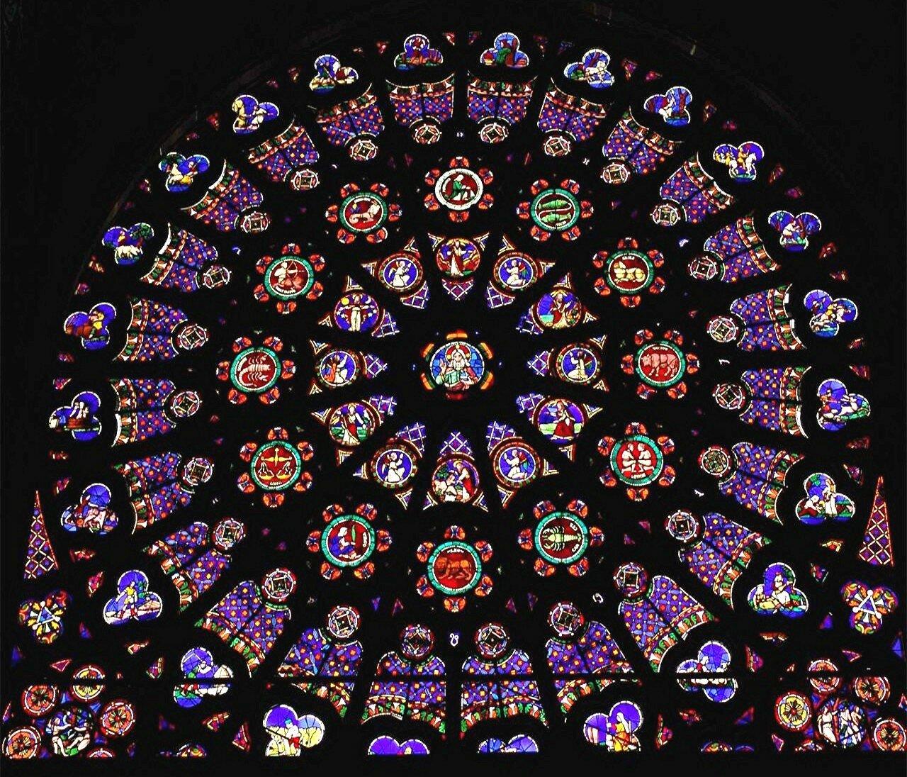 Widok na północną rozetę wkościele Saint Denis, zespół Stworzenia Źródło: TTaylor, Widok na północną rozetę wkościele Saint Denis, zespół Stworzenia, licencja: CC BY-SA 3.0.