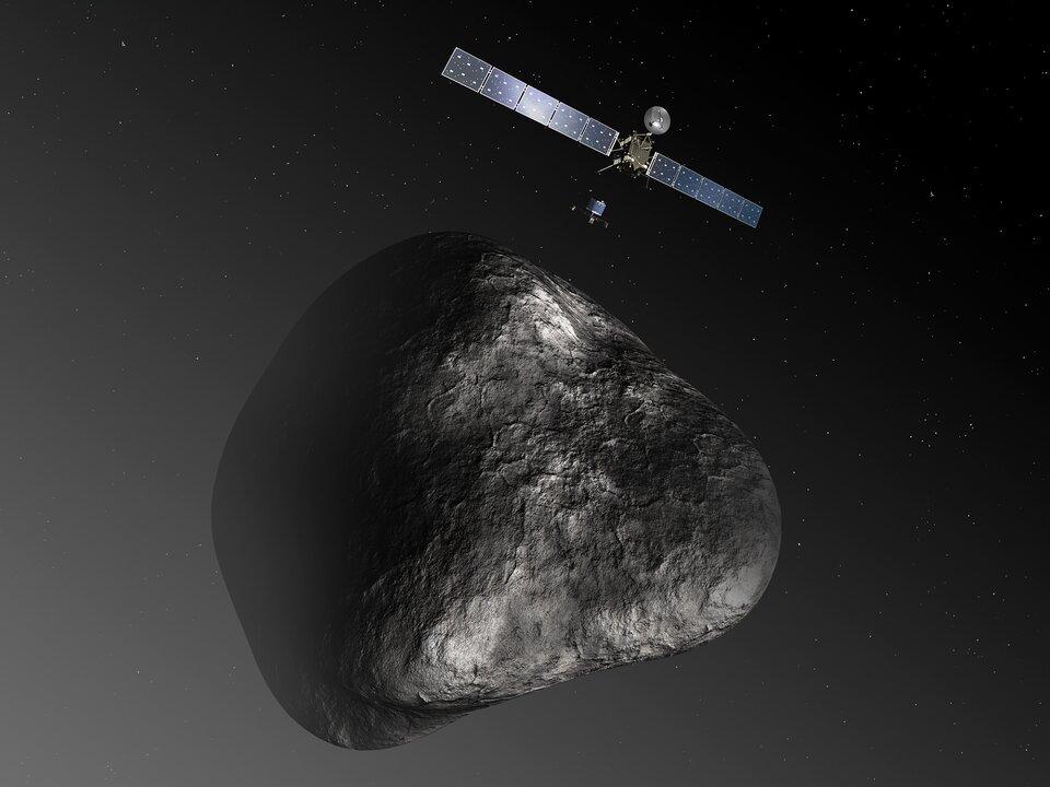 Na zdjęciu skalista bryła krążąca wciemnej przestrzeni. Nad nią sonda. Kadłub sondy ma kształt prostopadłościanu. Zprzeciwnych stron kadłuba rozpościerają się dwa panele ogniw słonecznych. Poniżej sondy lądownik wkształcie cylindra ztrójnożną podstawą.