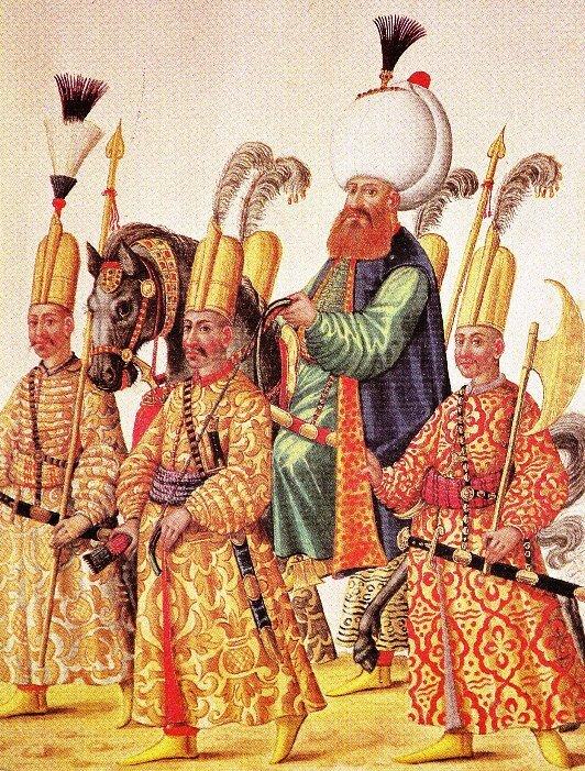 Wielki wezyr sułtana osmańskiego wotoczeniu swojej strażyprzybocznej – rysunek wrękopisie austriackim zkońca XVI w. Wielki wezyr sułtana osmańskiego wotoczeniu swojej strażyprzybocznej – rysunek wrękopisie austriackim zkońca XVI w. Źródło: ok. 1590, domena publiczna.
