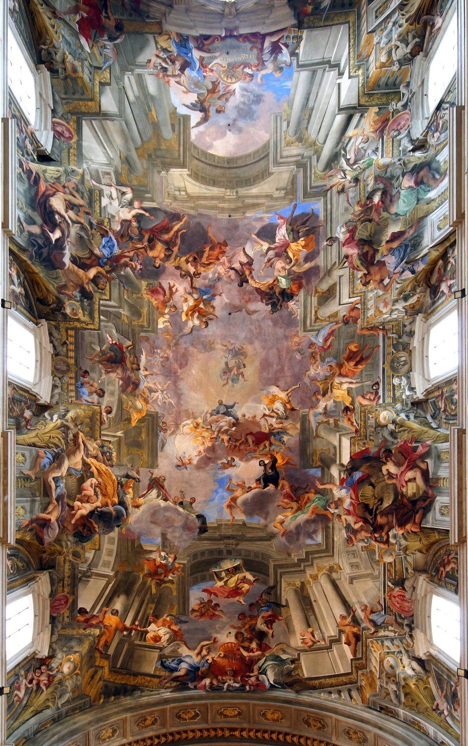 """Malarstwo iluzjonistyczne Andrea del Pozzo przedstawiające""""Apoteozęśw. Ignacego"""", znajduje się wkościele Il Gesu wRzymie. Malarstwo iluzjonistyczne Andrea del Pozzo przedstawiające""""Apoteozęśw. Ignacego"""", znajduje się wkościele Il Gesu wRzymie. Źródło: Bruce McAdam, Wikimedia Commons, licencja: CC BY-SA 2.0."""