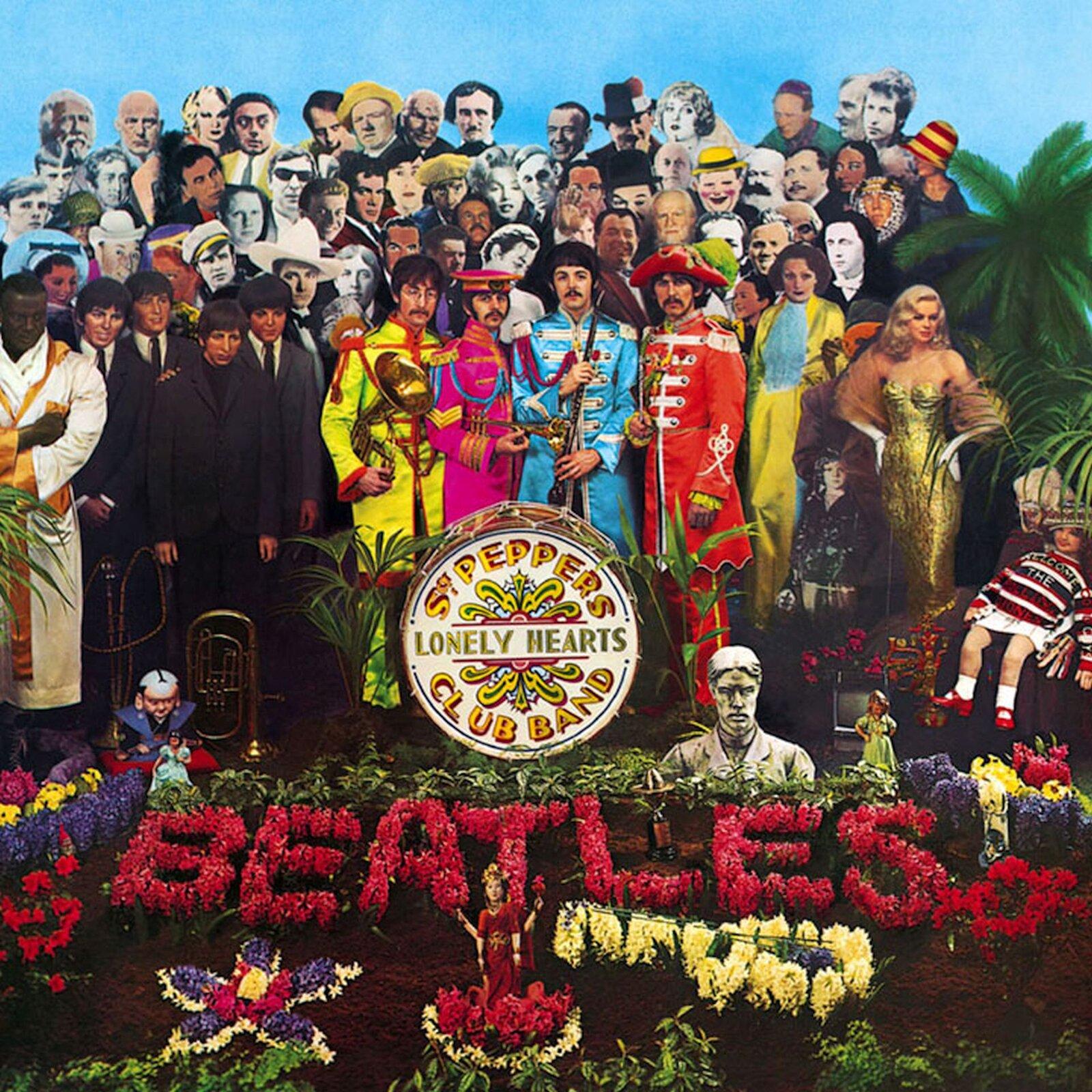 Ilustracja interaktywna przedstawia dużą grupę ludzi wróżnokolorowych strojach uich stup widać kolorowe kwiaty iułożony zczerwonych kwiatów napis Beatles .