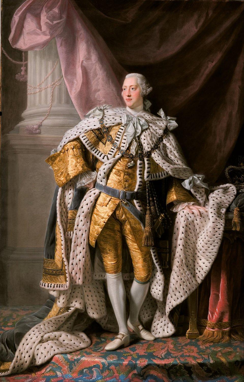 """Król Jerzy III wstroju koronacyjnym, ok. 1765 r. KrólJerzy III wstroju koronacyjnym, ok. 1765 r. Obraz pędzla Allana Ramsay'a znajdujący się obecnie wGalerii Sztuki wAdelajdzie wAustralii. Obraz powstał wokresie największego triumfu tzw. """"pierwszego imperium brytyjskiego"""" po zwycięstwie wwojnie siedmioletniej. Źródło: Allan Ramsay, Król Jerzy III wstroju koronacyjnym, ok. 1765 r., ok. 1765, olej na płótnie, Art Gallery of South Australia, domena publiczna."""