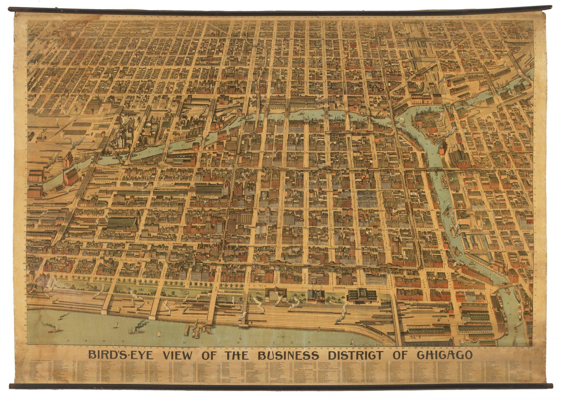 Ilustracja przedstawia widok na miasto Chicago zlotu ptaka. Na zdjęciu widoczny jest układ ulic ifragment rzeki. Ulice przecinają się między sobą pod kątem prostym tworząc szachownicę. Jest to mapa z1898.