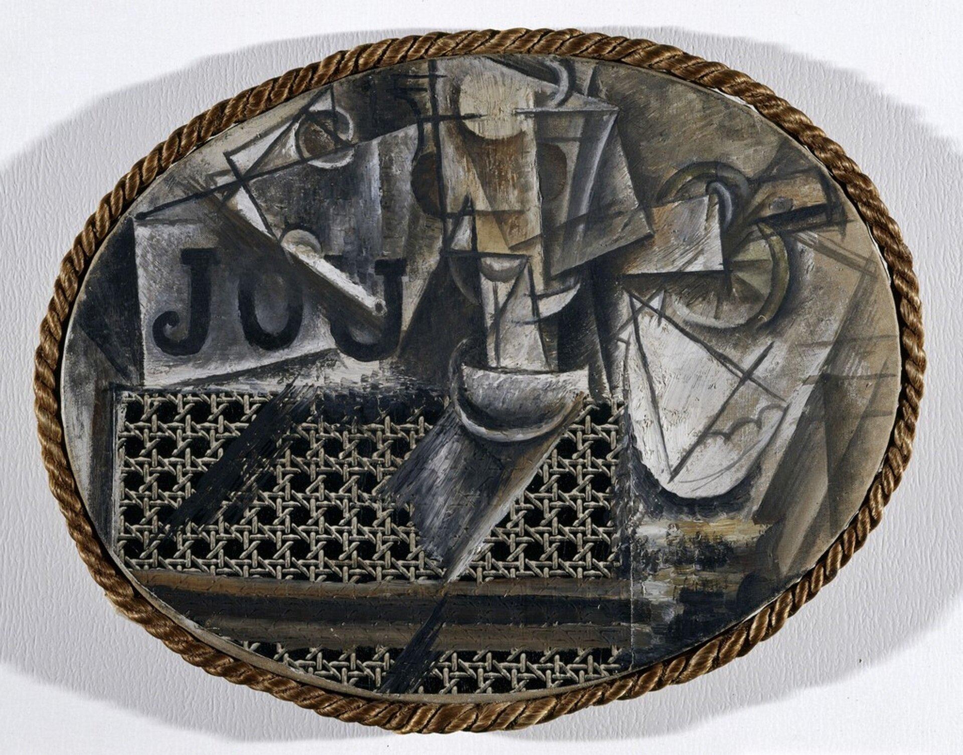 """Ilustracja przedstawia obraz Pablo Picasso pt. """"Martwa natura zwyplatanym krzesłem"""". Obraz pochodzi z1912 roku. Na ilustracji znajduje się brązowe koło, wktórego wnętrzu umieszczone są różne przedmioty. Widoczne jest wyplatane krzesło. Artysta uznawany za jednego znajwybitniejszych artystów XX wieku. Picasso wraz zGeorgesem Braque są twórcami nurtu malarstwa zwanego kubizmem."""