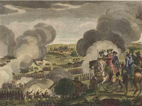 Bitwa pod Pragą w1757 r., wktórej zwycięstwo odniosła armia Prus; kolorowana grafika zok. 1780 r. (w oddali widać miasto Pragę) Bitwa pod Pragą w1757 r., wktórej zwycięstwo odniosła armia Prus; kolorowana grafika zok. 1780 r. (w oddali widać miasto Pragę) Źródło: ok. 1780, domena publiczna.