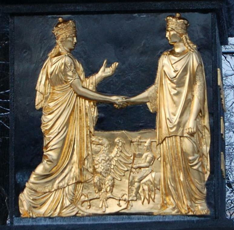 Płaskorzeźba na pomniku Unii Lubelskiej wLublinie przedstawiająca Koronę iLitwę Źródło: Szater, Płaskorzeźba na pomniku Unii Lubelskiej wLublinie przedstawiająca Koronę iLitwę, fotografia, licencja: CC BY-SA 3.0.