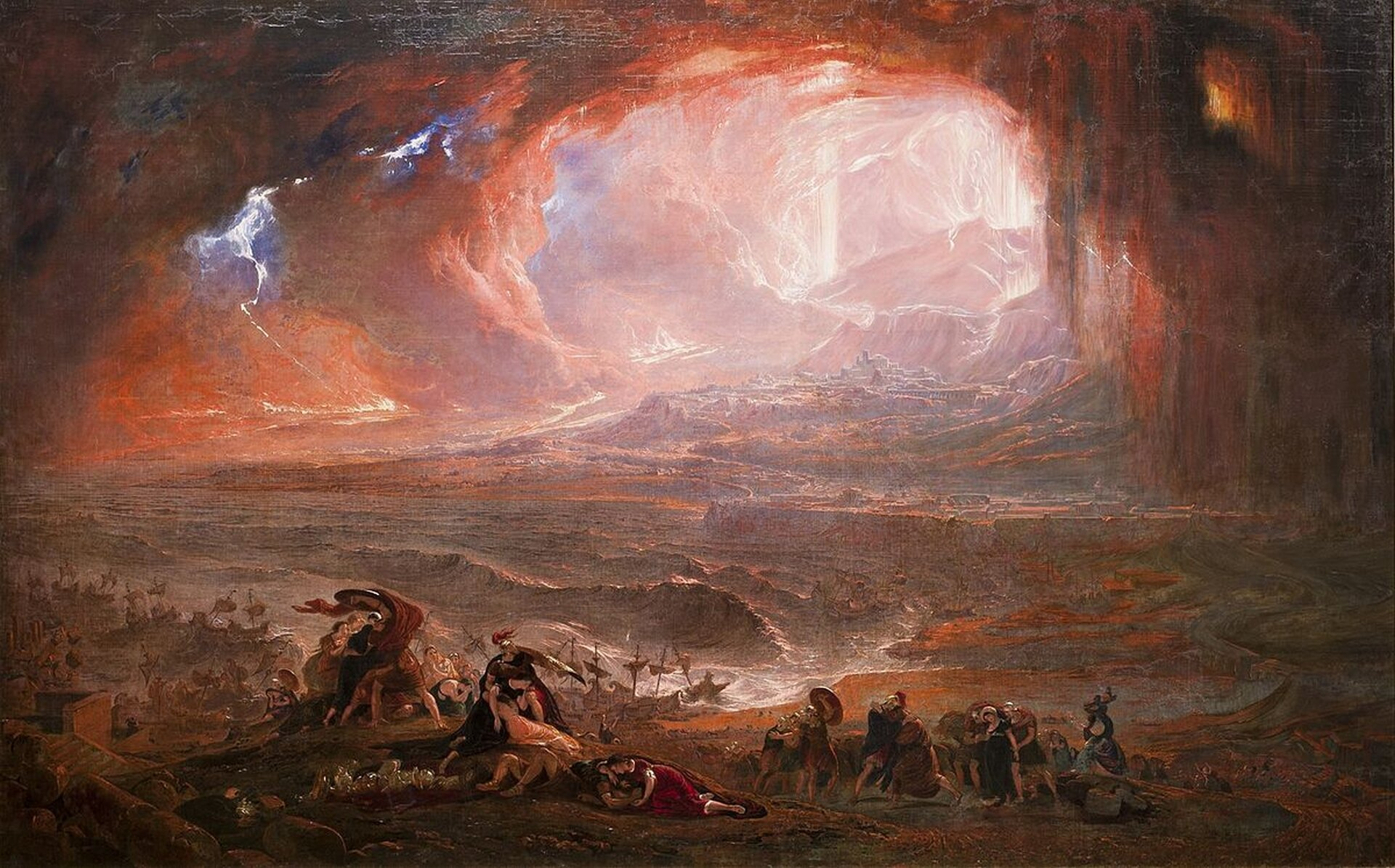 """Ilustracja przedstawia dzieło Johna Martina """"Zniszczenie Pompejów iHerculaneum"""". Na obrazie ukazano wybuch Wezuwiusza. Wcentrum obrazu olbrzymie ogniste chmury rozpościerają się nad ciemnym wzburzonym morzem. Na brzegu morza widoczne są małe, targane falami statki. Na pierwszym planie znajduje się grupa przerażonych ludzi."""