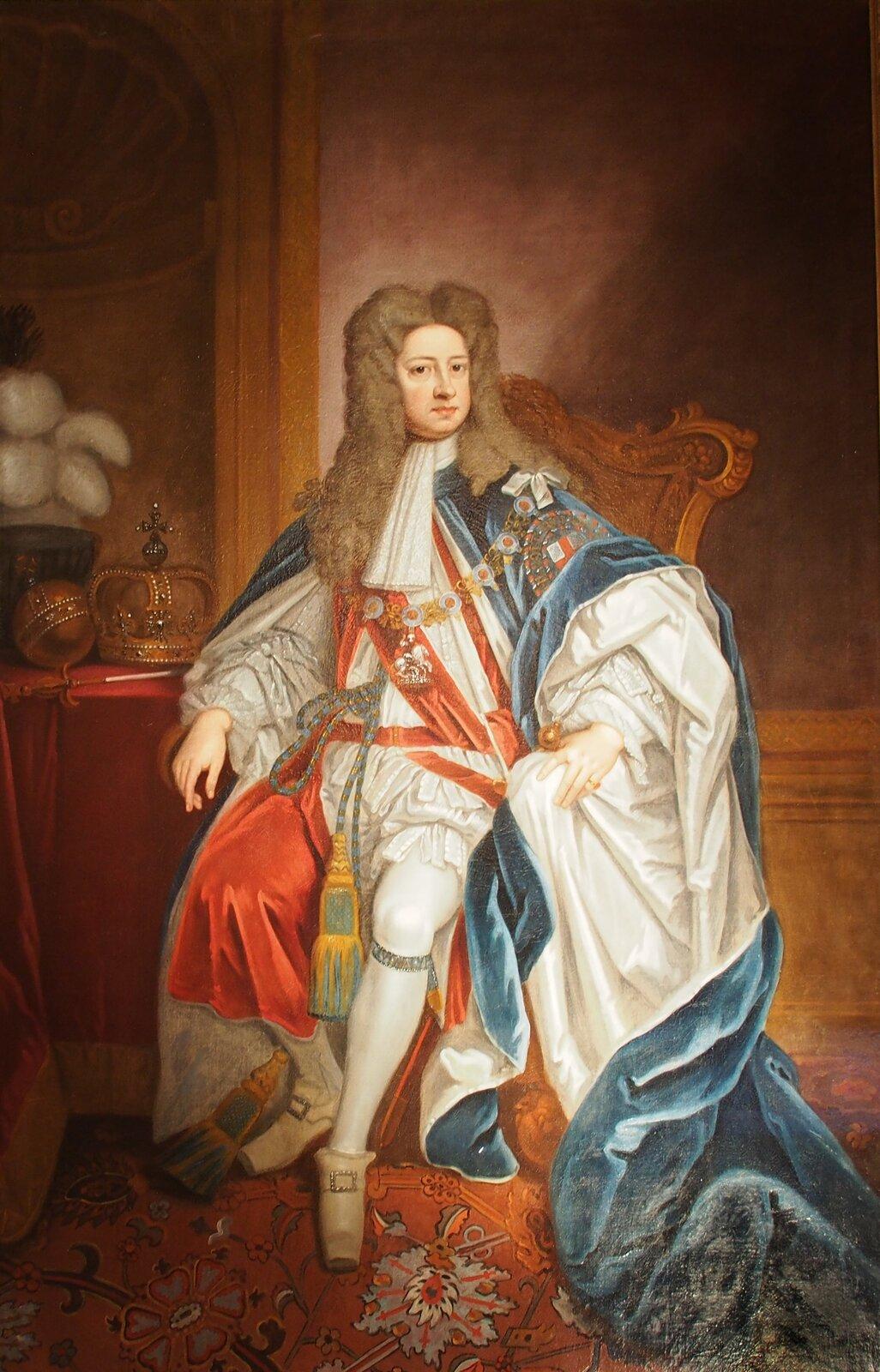 """Jerzy,książę Hanoweru, przyszły król Anglii Jerzy I; portret zok. 1701 r. namalowany przez znanego portrecistę Godfreya Knellera.W1701 r. wAnglii wydano """"Akt osukcesji"""" (Act of Settelment). Jerzy,książę Hanoweru, przyszły król Anglii Jerzy I; portret zok. 1701 r. namalowany przez znanego portrecistę Godfreya Knellera.W1701 r. wAnglii wydano """"Akt osukcesji"""" (Act of Settelment). Źródło: Godfrey Kneller, XIX w., olej na płótnie, Residenzmuseum im Celler Schloss, domena publiczna."""