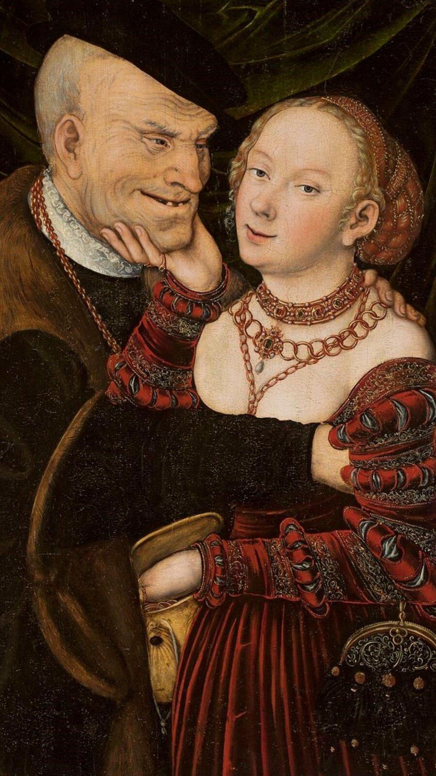 """Obraz pt. """"Niedobrana para"""" przedstawia mężczyznę ikobietę. Kobieta trzyma twarz mężczyzny. Ten patrzy na nią isię uśmiecha."""