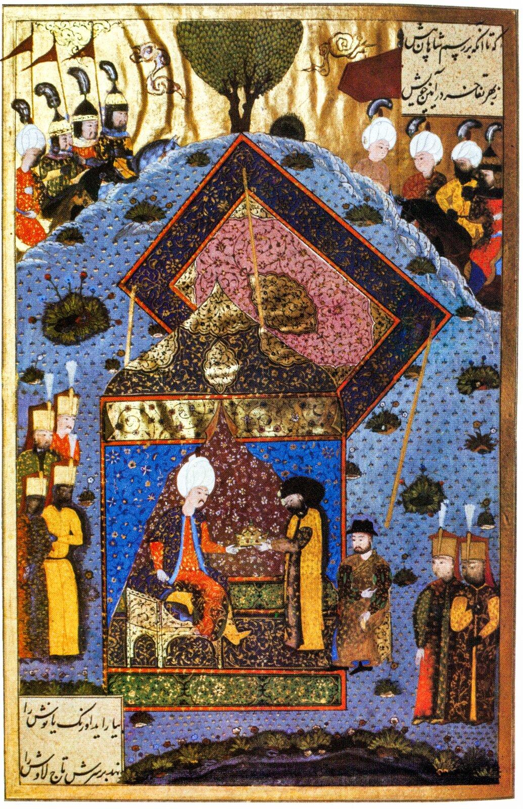 Sułtan Sulejman Wspaniały przekazuje koronę św. Stefana, symbol królów Węgier, Janowi Zapolyi w1528 r. Sulejman Wspaniały, sułtan osmański, po bitwie pod Mohaczem sprzymierzył się zJanem Zapolyą ipomógł mu uzyskać tron węgierski. Na miniaturze Zapolya otrzymuje zrąk sułtanakoronę św. Stefana - symbol królów Węgier. Źródło: artysta nieznany, Sułtan Sulejman Wspaniały przekazuje koronę św. Stefana, symbol królów Węgier, Janowi Zapolyi w1528 r., XVI wiek, Topkapi Palace Museum, domena publiczna.