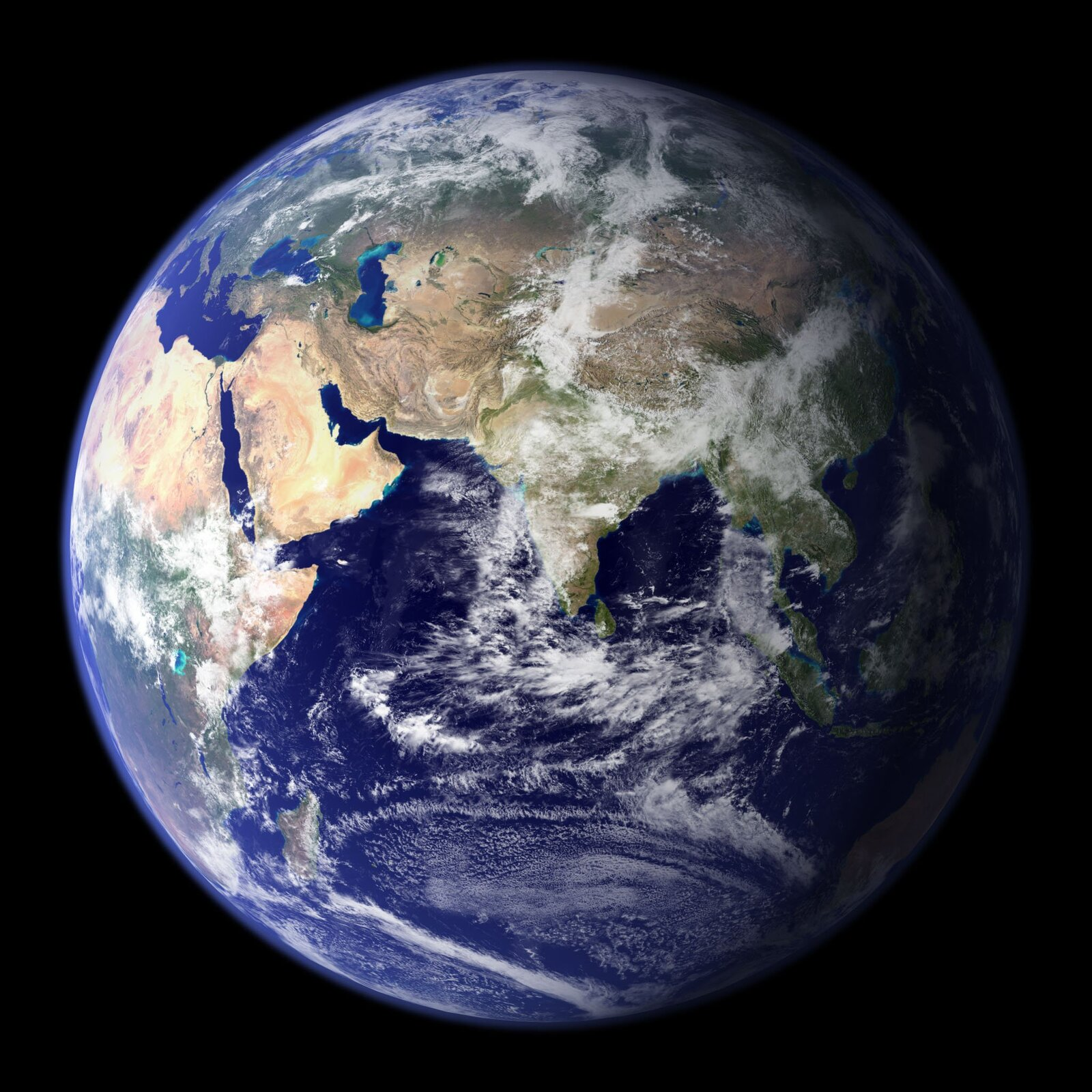Zdjęcie przedstawia Ziemię zkosmosu. Wcentrum zdjęcia Półwysep Indyjski iAzja Centralna, po lewej stronie Afryka iEuropa. Słońce najbardziej intensywnie oświetla Afrykę iEuropę, Japonia iIndochiny wcieniu. Całą dolną część globu zajmuje Ocean Indyjski. Morza, oceany ikontynenty częściowo przesłonięte przez warstwę chmur.