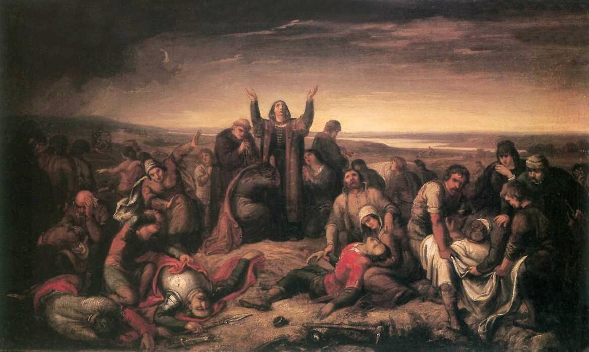 Dorota Kanizsai wśród trupów po bitwie pod Mohaczem W1526 roku wielokrotnie silniejsze wojska Sulejmana Wspaniałego rozgromiły armię węgierską. Straty oddziałów dowodzonych przezLudwika II były ogromne - życie straciło prawie 2/3 żołnierzy. Wśród poległych była prawie cała magnateria, wtym biskupi. Na obrazie widaćDorotę Kanizsai, arystokratkę węgierską, wdowę po komorniku koronnym, której dwaj przybrani synowie zginęli wbitwie.Kanizsai była osobą, która zorganizowała zbiorowypogrzeb ofiar, zatrudniając wtym celu prawie pięćset osób. Datę bitwy pod Mohaczem uznaje się za symboliczny kres potęgi Jagiellonów. Źródło: Soma Orlai Petrich, Dorota Kanizsai wśród trupów po bitwie pod Mohaczem, ok. 1860 r., olej na płótnie, Węgierskie Muzeum Narodowe, domena publiczna.