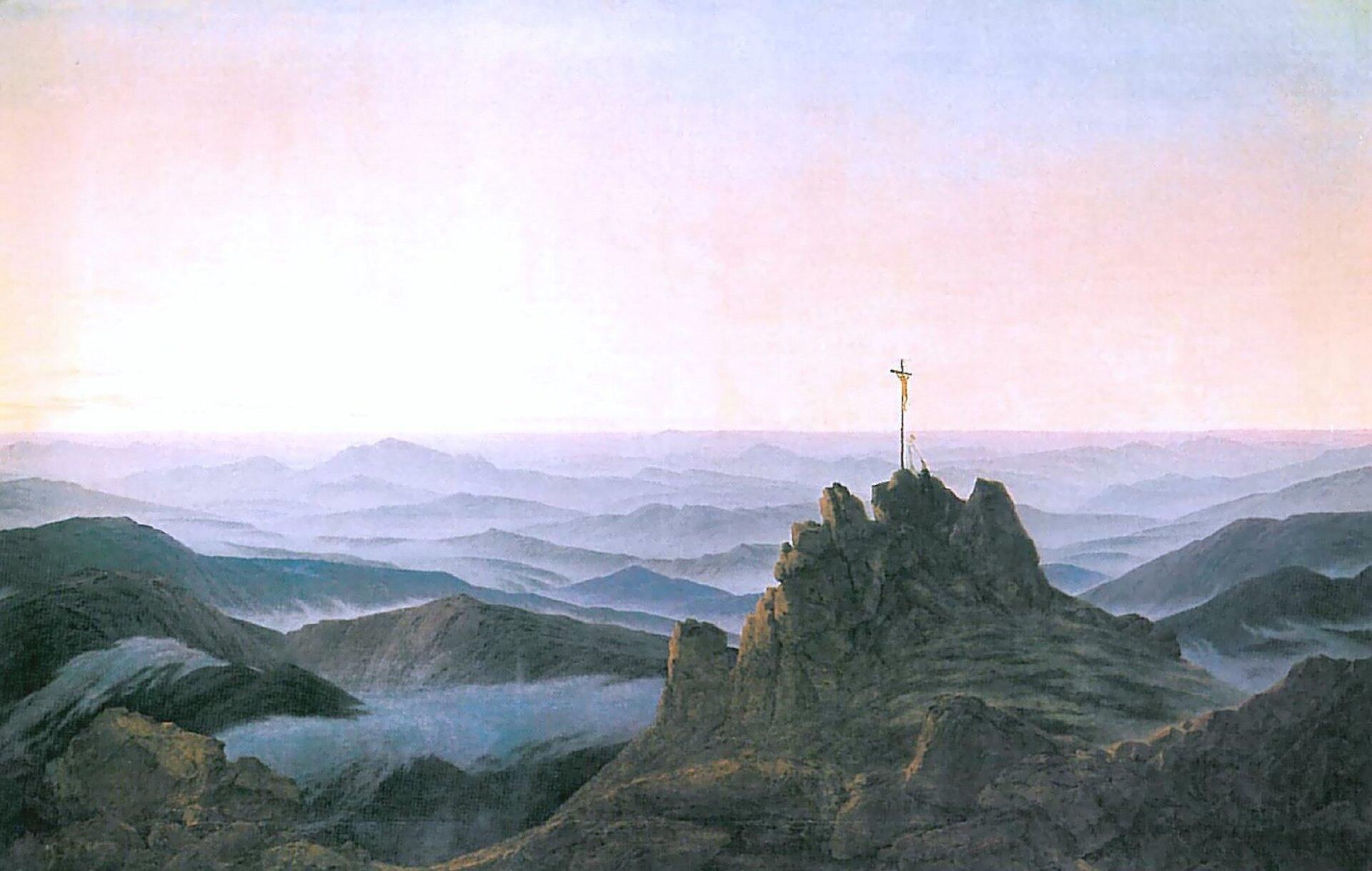 """Ilustracja okształcie poziomego prostokąta przedstawia obraz Caspara Davida Friedricha """"Poranek wKarkonoszach"""". Ukazuje spowite we mgle szczyty Karkonoszy. Na najwyższym szczycie osadzony jest krzyż. Góry układają się wpoziomie, tworząc pasy, przeplatające się zfioletowymi warstwami mgły. Oddalony pejzaż na horyzoncie  łączy się ztłem, którym jest jasne, cieniowane od bieli do różów ifioletów niebo."""