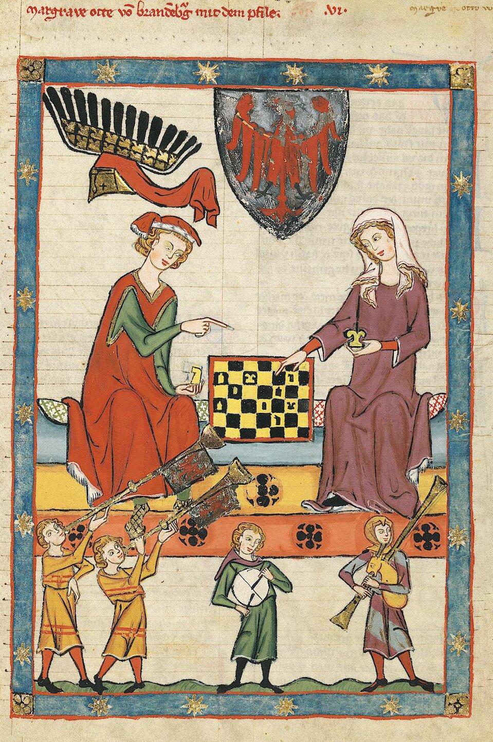 Miniaturazpierwszej poł. XIV w. zrękopisu przechowywanego obecnie wHeidelbergu. Obraz przedstawia księcia Ottona IV zBambergu grającego wszachy zjakąś niewiastą, udołu przygrywają im muzycy. Zwróć uwagę, jak namalowano szachownicę ijak namalowano muzyków (postacie są znacznie mniejsze niż książę). Miniaturazpierwszej poł. XIV w. zrękopisu przechowywanego obecnie wHeidelbergu. Obraz przedstawia księcia Ottona IV zBambergu grającego wszachy zjakąś niewiastą, udołu przygrywają im muzycy. Zwróć uwagę, jak namalowano szachownicę ijak namalowano muzyków (postacie są znacznie mniejsze niż książę). Źródło: Meister des Codex Manesse, 1305-1340, domena publiczna.