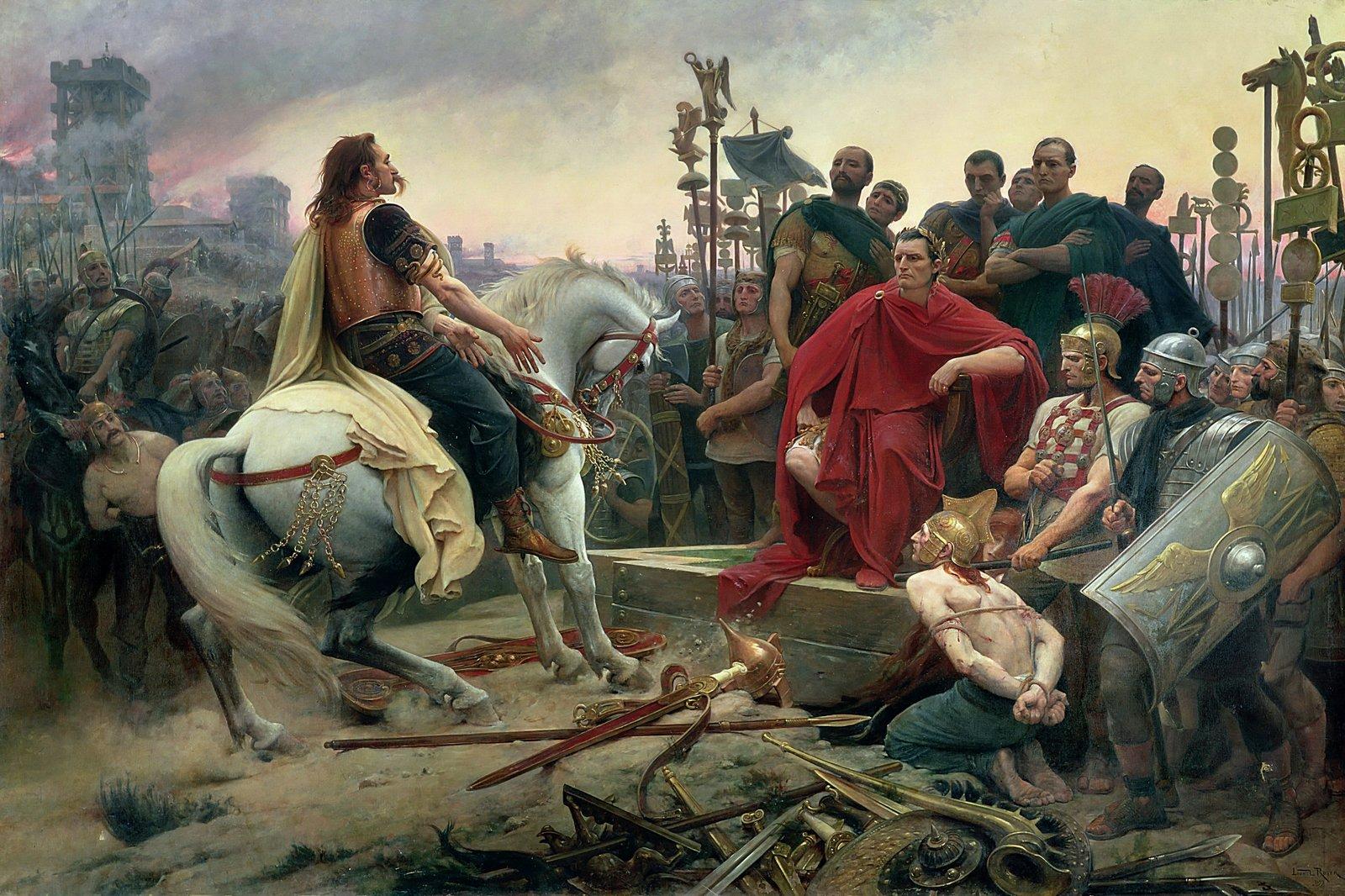 Obraz przedstawiający poddanie się Wercyngetoryksa Cezarowi. Na fotelu, otoczony grupą mężczyzn siedzi ubrany wczerwoną szatę mężczyzna. Po jego lewej stronie na ziemi klęczy związany człowiek, aprzy nim stoją żołnierze zwłóczniami. Przed siedzącym mężczyzną na koniu siedzi wąsaty mężczyzna ubrany wmiedzianą zbroję, którzy rzuca na ziemię, ustóp siedzącego, swoją broń - miecz iwłócznię. Wtle, na tyczkach, stoją proporce isymbole rzymskich legionów