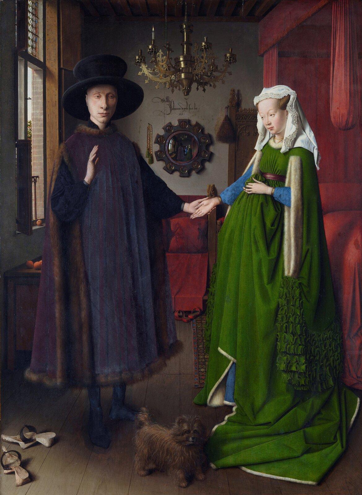 """Ilustracja przedstawia obraz olejny """"Portret małżonków Arnolfinich"""" autorstwa Jana van Eycka. Dzieło ukazuje ceremonię przysięgi małżeńskiej. We wnętrzu pokoju stoi młoda para. Mężczyzna, stojący po lewej stronie ubrany jest wdługi, ciemny płaszcz podszyty brązowym futrem. Na głowie ma duży kapelusz. Prawą rękę unosi do góry, natomiast wlewej trzyma dłoń stojącej obok kobiety. Narzeczona ubrana jest wdługą, zieloną, drobno pofałdowaną suknię zniebieskimi rękawami. Jej głowę okrywa wykończona koronką, biała chusta. Złagodnością spogląda na poważną twarz mężczyzny składającego przysięgę. Wtle znajduje się wnętrze oszarych ścianach idrewnianej podłodze. Zokna po lewej stronie wpada do pokoju światło. Po prawej ukazane jest duże, czerwone łoże zbaldachimem. Zsufitu zwisa ozdobny, wieloramienny żyrandol zbrązu. Na ścianie, pomiędzy małżonkami umieszczone zostało wypukłe lustro, wktórym odbija się młoda para wraz ze świadkami. Na dole obrazu artysta namalował małego kudłatego pieska oraz parę drewnianych chodaków."""