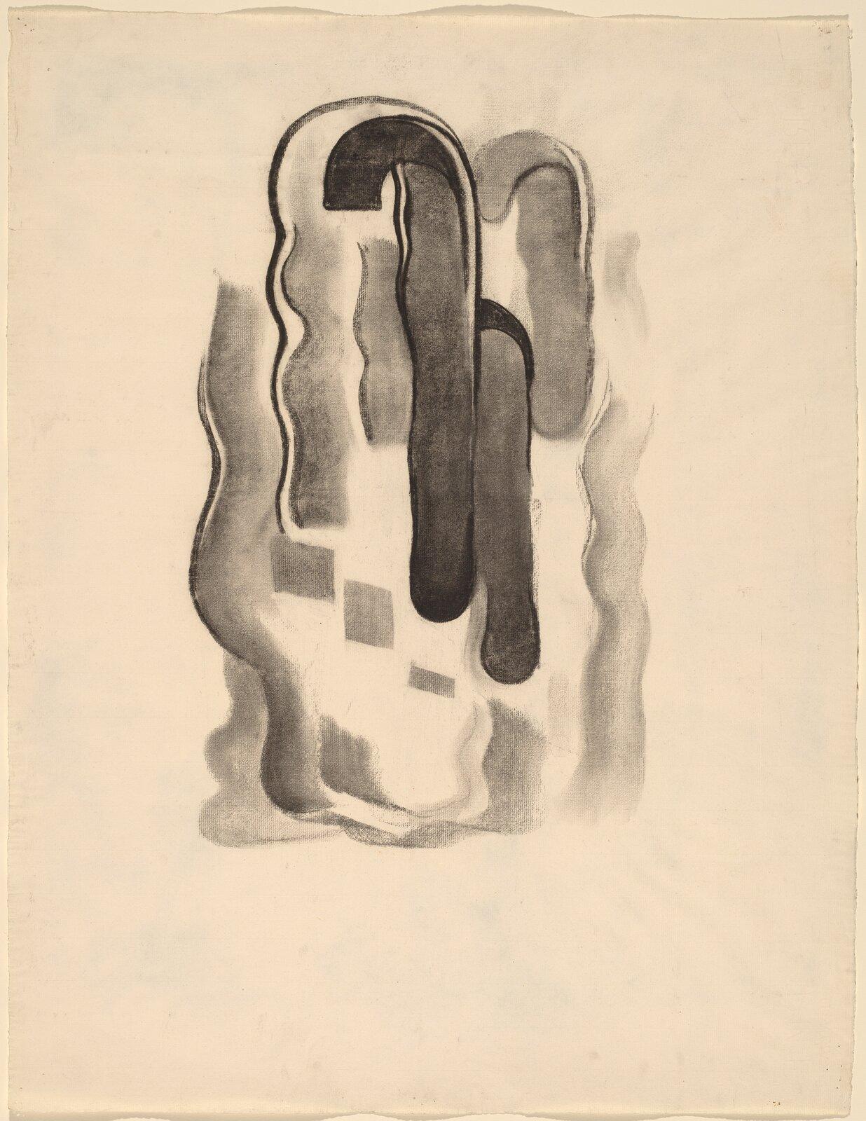 """Ilustracja przedstawia rysunek """"Numer 7 specjalny"""" autorstwa Georgii O'Keeffe. Zamknięta, statyczna kompozycja ukazuje formę abstrakcyjną. Na środku pożółkłej kartki znajdują się narysowane czarnym węglem szerokie iwąskie linie oróżnym natężeniu, układające się wkształt otwartej dłoni."""