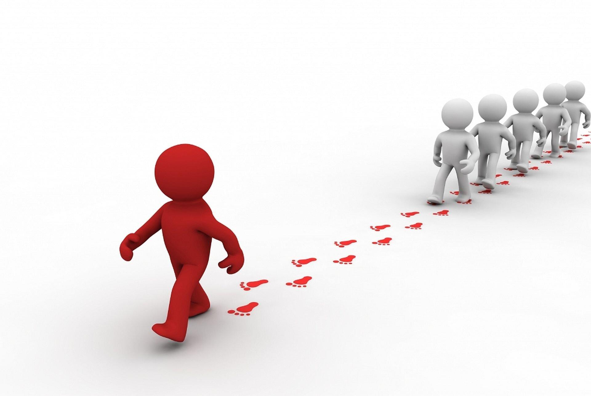Ilustracja przedstawia czerwonego ludzika, które idzie kilkoro niebieskich ludzików.