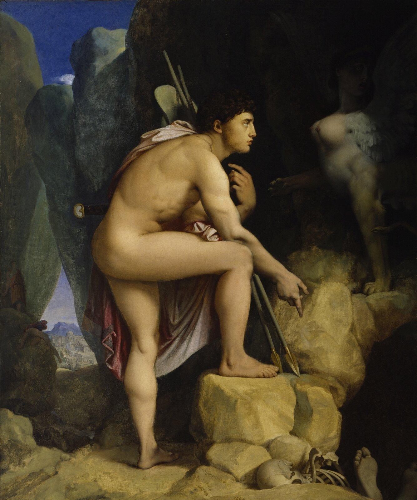 """Ilustracja przedstawia pracę Jean Auguste Dominique Ingres pod tytułem """"Edyp iSfinks"""". Ilustracja przedstawia nagiego Edypa, który ma przy sobie włócznię oraz szatę przerzuconą przez ramię. Edyp spotyka Sfinksa, który ma tors oraz głowę urodziwej kobiety. Edyp wraz ze Sfinksem znajdują się wgórach, koło jaskini. Pod kamieniami widoczne są kości oraz nogi człowieka."""
