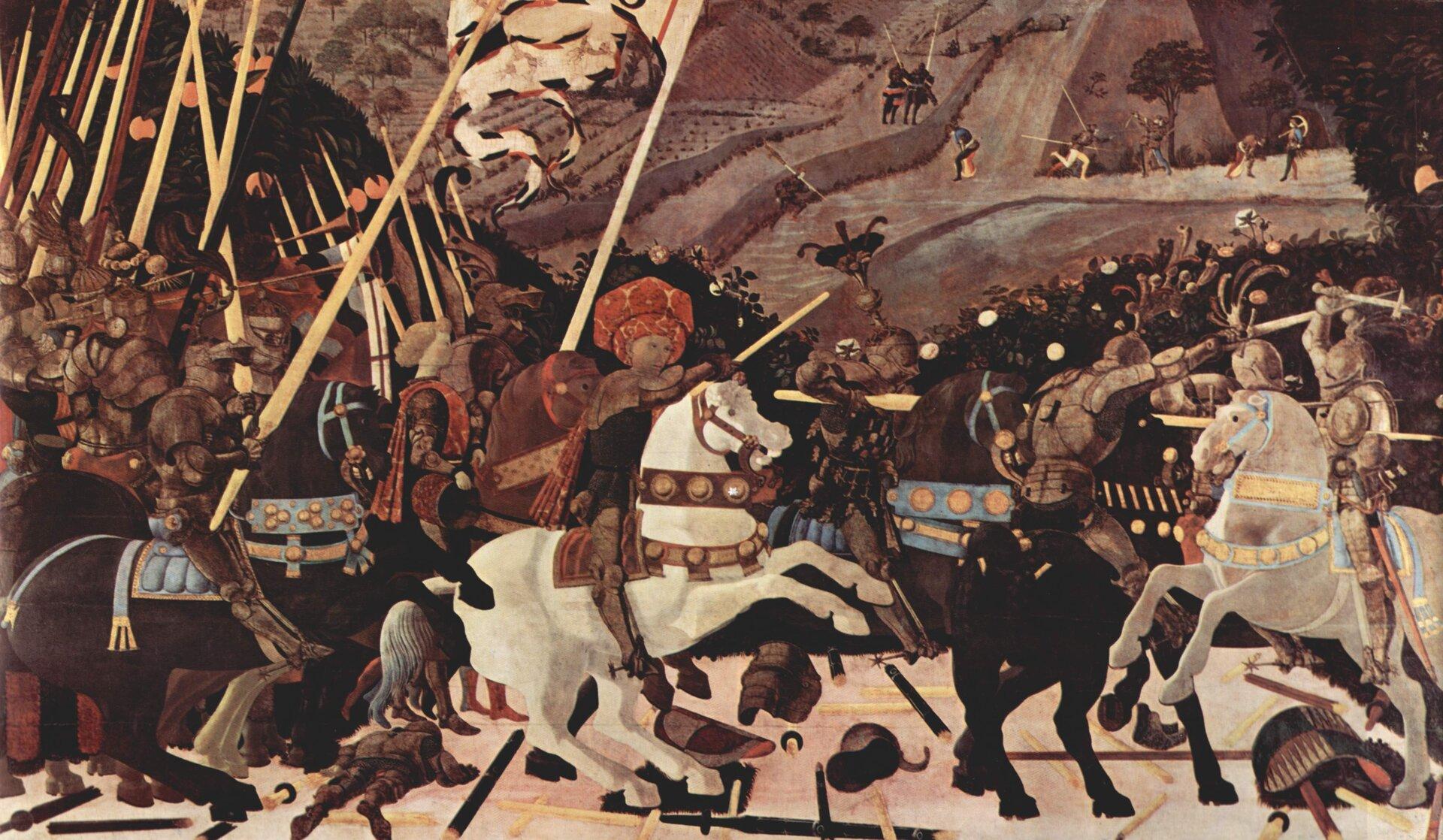 """Ilustracja przedstawia obraz Paola Uccello, """"Bitwa pod San Romano"""". Ukazuje scenę bitwy. Wcentralnej części obrazu, na białym koniu wojskami Florencji dowodzi kondotier, Niccolò da Tolentino, dosiadającego białego, stającego dęba konia. Mężczyzna ma na sobie rycerską zbroję iturban. Wprawej trzyma laskę dowódczą. Za nim na koniach podąża grupa uzbrojonych wlance rycerzy. Jeden znich trzyma sztandar. Pomiędzy rycerzami młodzieńcy dmą wtrąby. Po prawej stronie, pomiędzy rycerzami toczy się walka. Scena rozgrywa się na tle wzgórza, na którym polują myśliwi. Woddali znajdują się dwaj rycerze na koniach."""