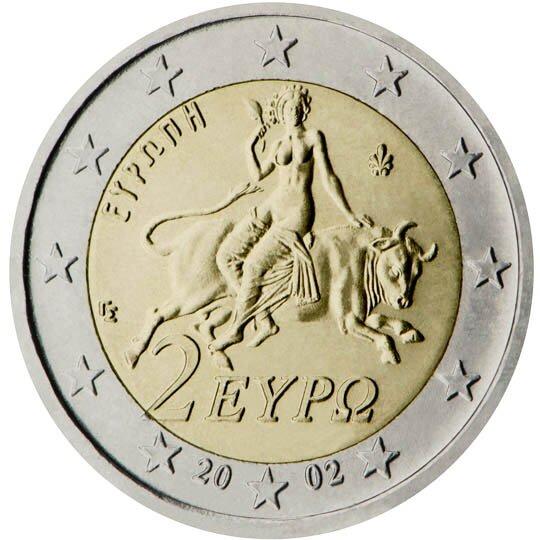 Ilustracja przedstawia rewers monety. Po środku kobieta siedząca na byku inapis dwa euro. Pod spodem data dwa tysiące dwa. Wszystko otacza dwanaście gwiazd.