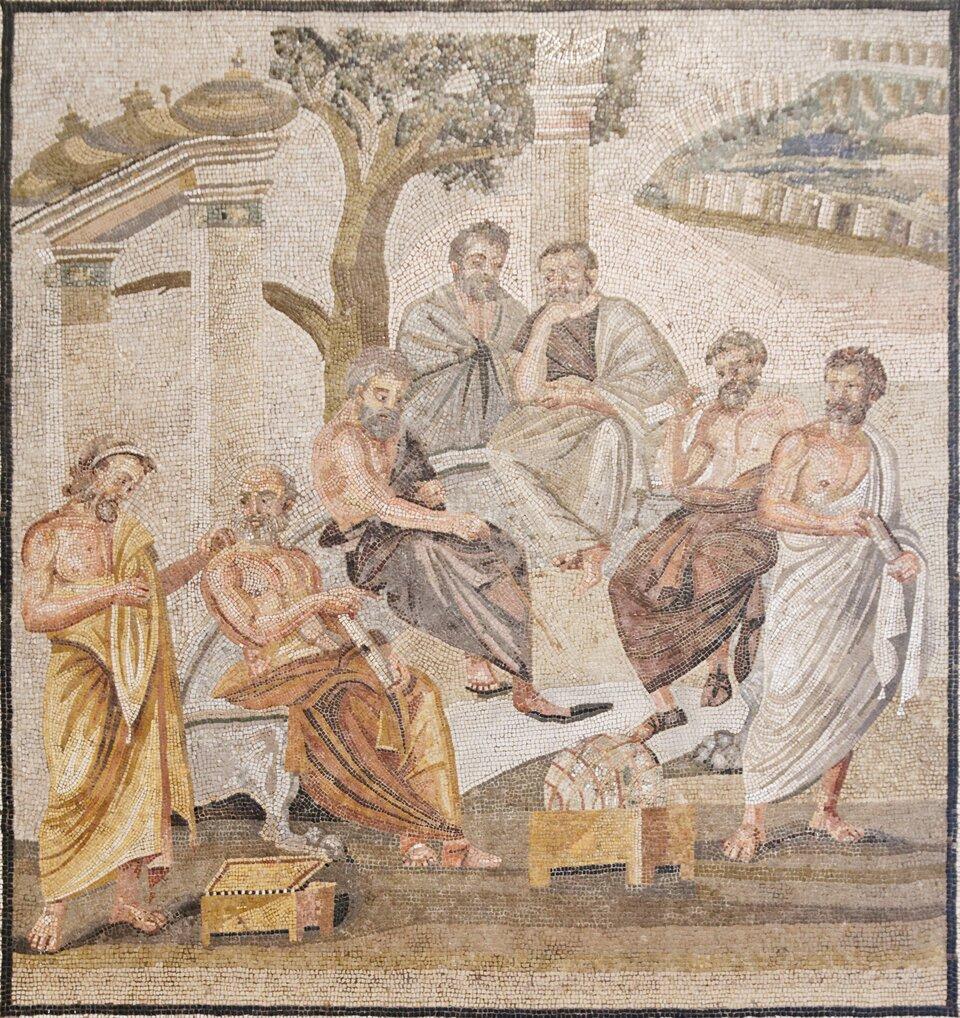 Mozaika przedstawiająca grupę filozofów dyskutujących wateńskiej Akademii. Źródło: Marie-Lan Nguyen, Mozaika przedstawiająca grupę filozofów dyskutujących wateńskiej Akademii., Naples National Archaeological Museum, licencja: CC 0.