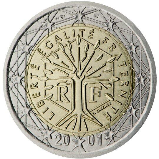 Ilustracja przedstawia rewers monety. Po środku drzewo iotaczający je napis: liberte egalite franternite. Pod spodem data dwa tysiące jeden. Wszystko otacza dwanaście gwiazd.