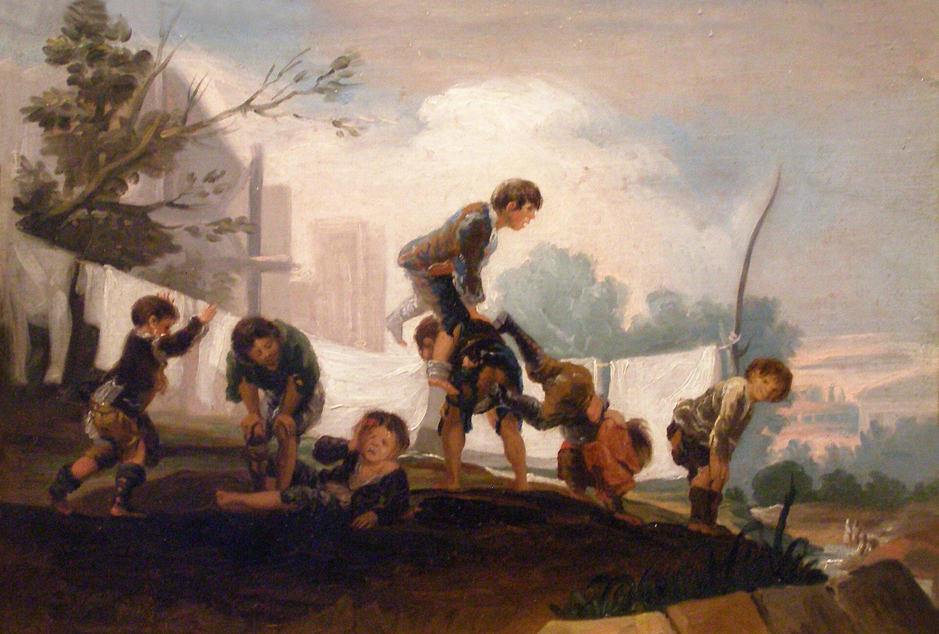 Zabawy dziecięce Dzieci przy zabawie pídola Źródło: Francisco Goya, Zabawy dziecięce, 1782–1785, domena publiczna.