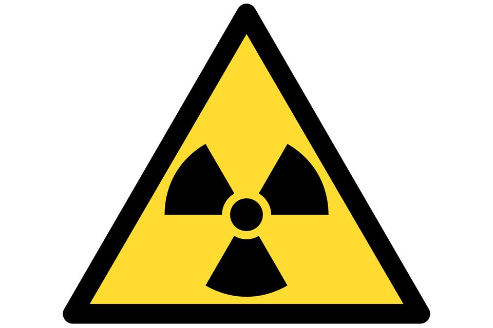 Grafika przedstawiająca symbol promieniotwórczości