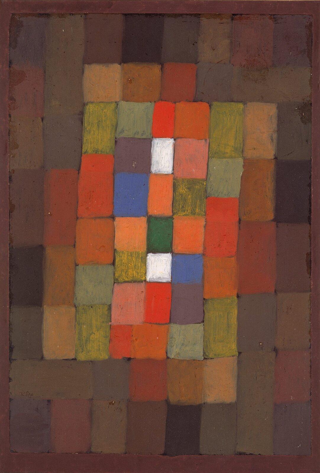 """Ilustracja przedstawia obraz """"Gradacja statyczno-dynamiczna"""" autorstwa Paula Klee. Namalowaną przez artystę kompozycję abstrakcyjną wypełniają różnokolorowe prostokąty ozróżnicowanych wielkościach. Wobrazie dominują brązy, które im bliżej środka zamieniają się wpomarańcze, czerwienie izielenie oróżnym nasyceniu. Wcentrum kompozycji artysta dodał dwa niebieskie prostokąty oraz dwa białe, które mocno wybijają się spośród beżowo-pomarańczowo-zielonych plam. Środek obrazu jest wyraźnie rozświetlony. Dzięki temu zabiegowi statyczna kompozycja składająca się zprostokątnych kształtów nabiera optycznej dynamiki. Dzieło łączy wsobie technikę akwareli ztuszem igwaszem."""