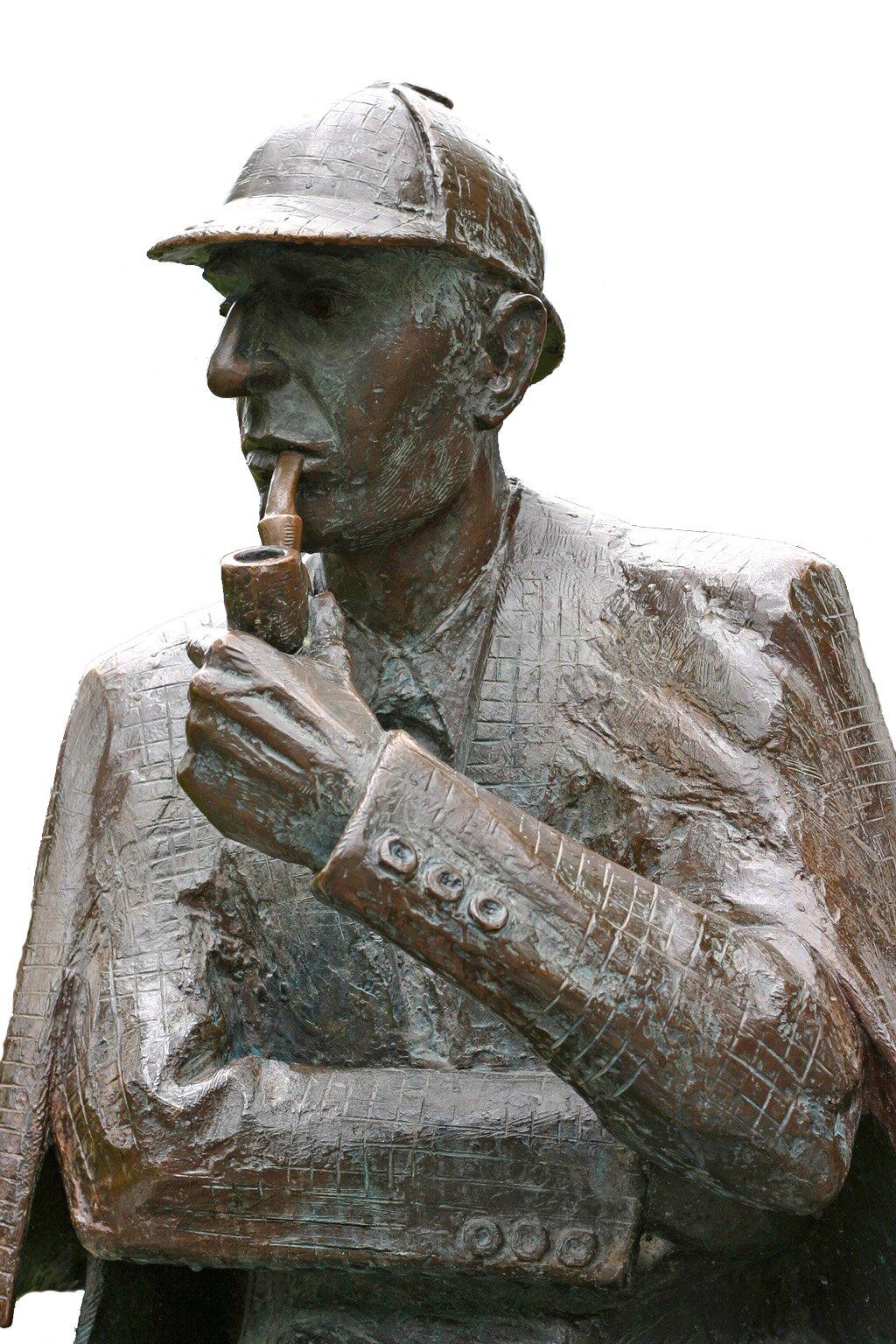 Pomnik Sherlocka Holmesa Pomnik Sherlocka Holmesa Źródło: John Doubleday, 1988, fotografia barwna, Meiringen, Szwajcaria, licencja: CC BY-SA 3.0.