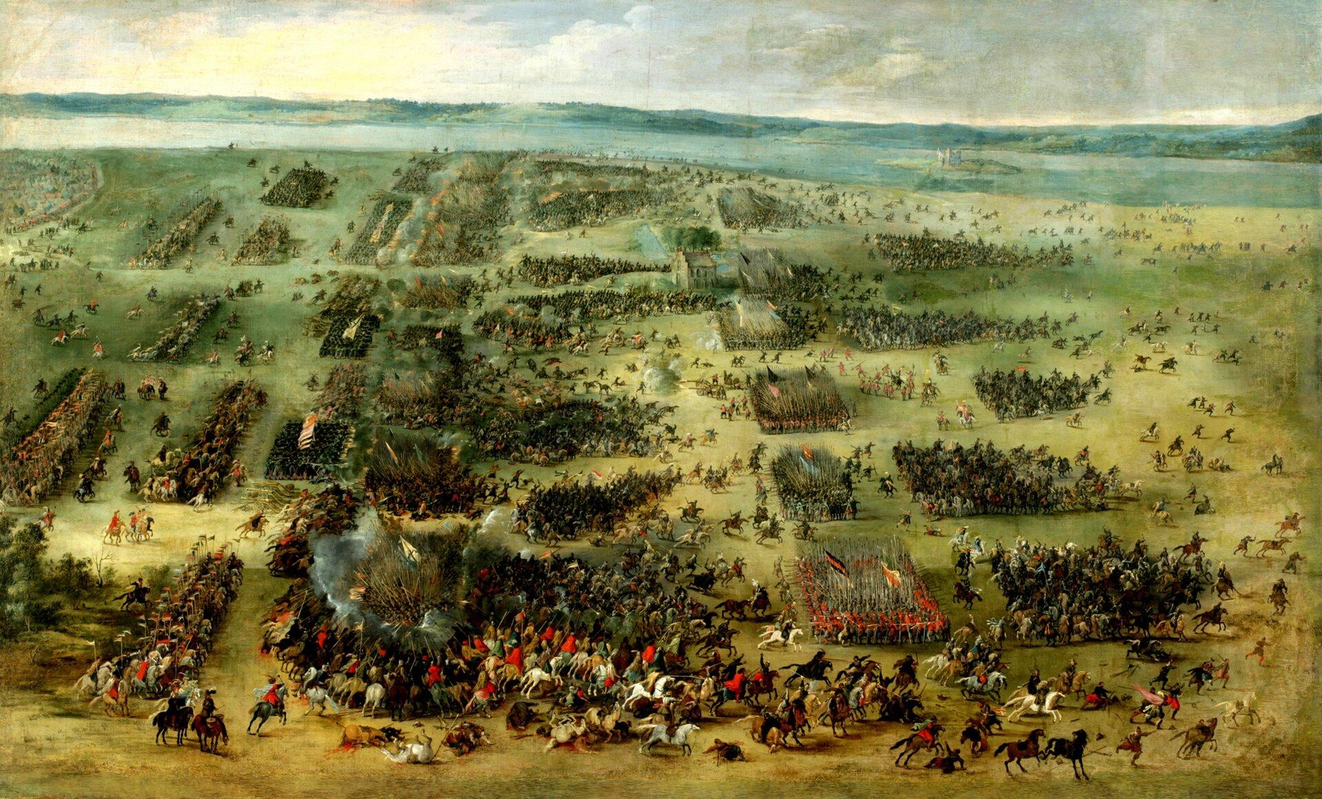 Bitwa pod Kirholmem w1605 r. Bitwa pod Kirholmem w1605 r. Zwycięstwo hetmana Jana Karola Chodkiewicza. Obraz Pietera Snayersa (1592-1666) był wposiadaniu Wazów. Jan Kazimierz zabrał go po swojej abdykacji w1668 do Francji, apo jego śmierci trafił na licytację izostał sprzedany. Obecnie jest wzbiorach prywatnych we Francji. Malarz pochodził zpołudniowych, hiszpańskich Niderlandów ispecjalizował się malarstwie scen batalistycznych. Namalował m.in. obrazy pokazujące bitwy: pod Białą Górą, oblężenie Wiednia w1529 itd. Źródło: Pieter Snayers, Bitwa pod Kirholmem w1605 r., olej na płótnie, Château de Sassenage, domena publiczna.