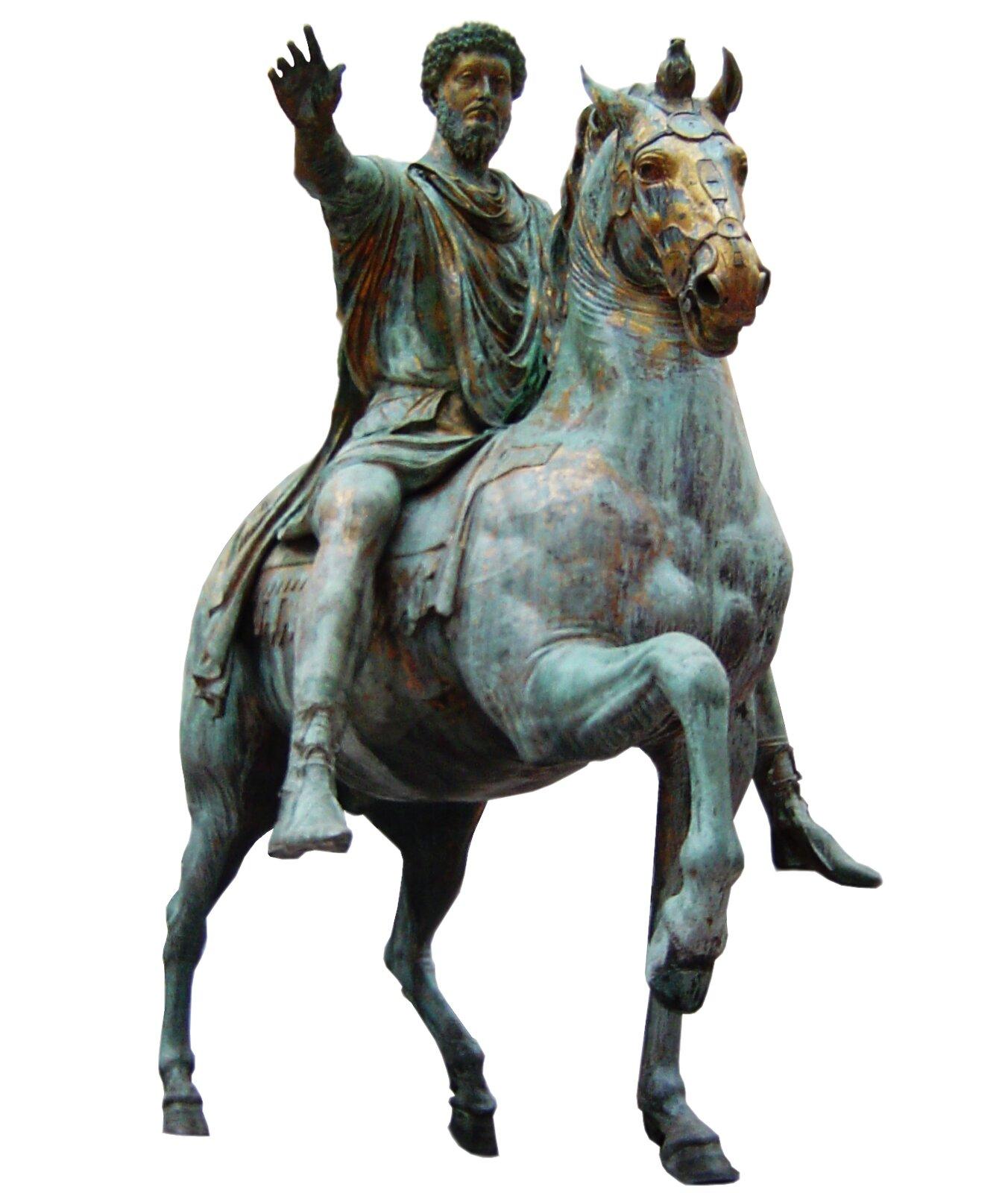 Rzeźba przedstawiająca brodatego mężczyznę siedzącego na koniu. Mężczyzna ma wyciągniętą przed siebie prawą rękę. Posąg jest zmetalu pokrytego zieloną patyną, wniektórych miejscach widać jednak złoty kolor metalu.