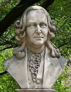 Zdjęcie prezentujące Karola Linneusza szwedzkiego przyrodnika. W1735 roku ogłosił dzieło System naturalny, wktórym przedstawił system klasyfikacji roślin izwierząt. Wprowadził zasady podwójnego nazewnictwa gatunków, które przetrwały do dziś. Pierwszy zaliczył człowieka do świata zwierząt.