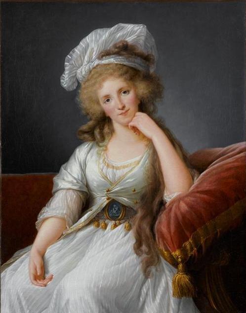 Moda okresu rewolucji icesarstwa we Francji (ok. 1800 r.) Źródło: Louise Élisabeth Vigée Le Brun, Moda okresu rewolucji icesarstwa we Francji (ok. 1800 r.), Olej na płótnie, Palace of Versailles, domena publiczna.