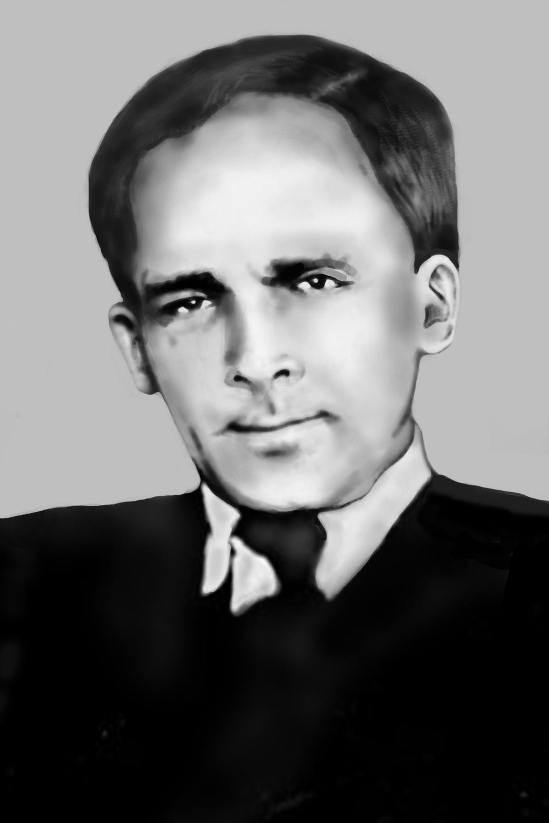 Ilustracja przedstawia Fritza Strassmanna. Mężczyzna wwieku ok. 45 lat. Czoło wysokie, uszy małe, usta wąskie. Oczy ciemne, kąciki oczu opadające. Brwi ciemne, średniej szerokości. Włosy ciemne, starannie uczesane. Przedziałek po prawej (jego lewej) stronie. Mężczyzna ubrany wczarny garnitur, białą koszulę iczarny krawat.