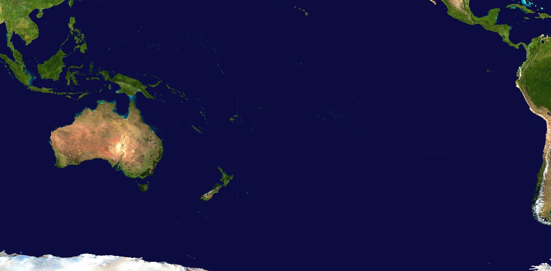Na zdjęciu satelitarnym kontynent Australii, dużo niebieskiego tła (ocean). Woddali fragment lądu Ameryki Środkowej iPołudniowej.