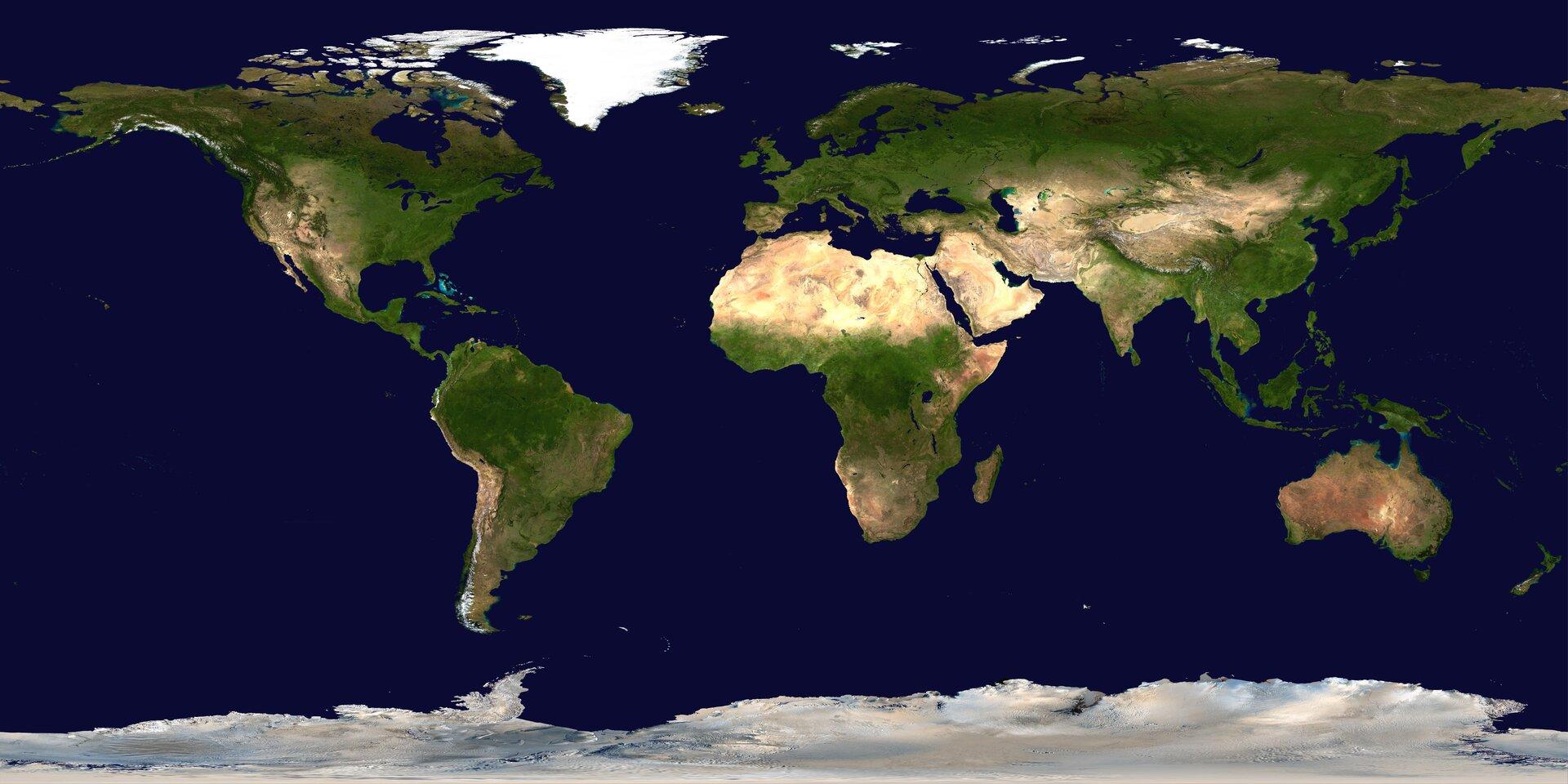 Na zdjęciu mapa świata powstała zpołączenia zdjęć satelitarnych powierzchni Ziemi. Wody granatowe, na lądach tereny zielone ipiaszczyste. Obszary na północy ipołudniu białe iszare – pokrywa śnieżna ilodowa.