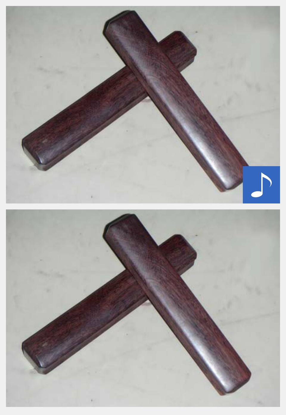 Ilustracja interaktywna - grafika przedstawiająca klawesy – dwie brązowe drewniane pałeczki, Po kliknięciu na grafikę zostanie wyświetlona informacja dodatkowa oraz odtworzony dźwięk tego instrumentu.