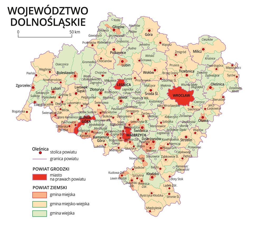 Mapa województwa dolnośląskiego. Na mapie fioletowymi liniami zaznaczono granice powiatów ziemskich, dużymi czerwonymi kropkami zaznaczono miasta będące stolicami powiatów. Wobrębie powiatów ziemskich kolorami wyróżniono gminy miejskie, miejsko-wiejskie iwiejskie. Czerwonym kolorem wyróżniono powiaty grodzkie zmiastami na prawach powiatu, miasta te opisano dużymi literami. Kolory iznaki użyte na mapie opisano wlegendzie. Wlegendzie podziałka liniowa.
