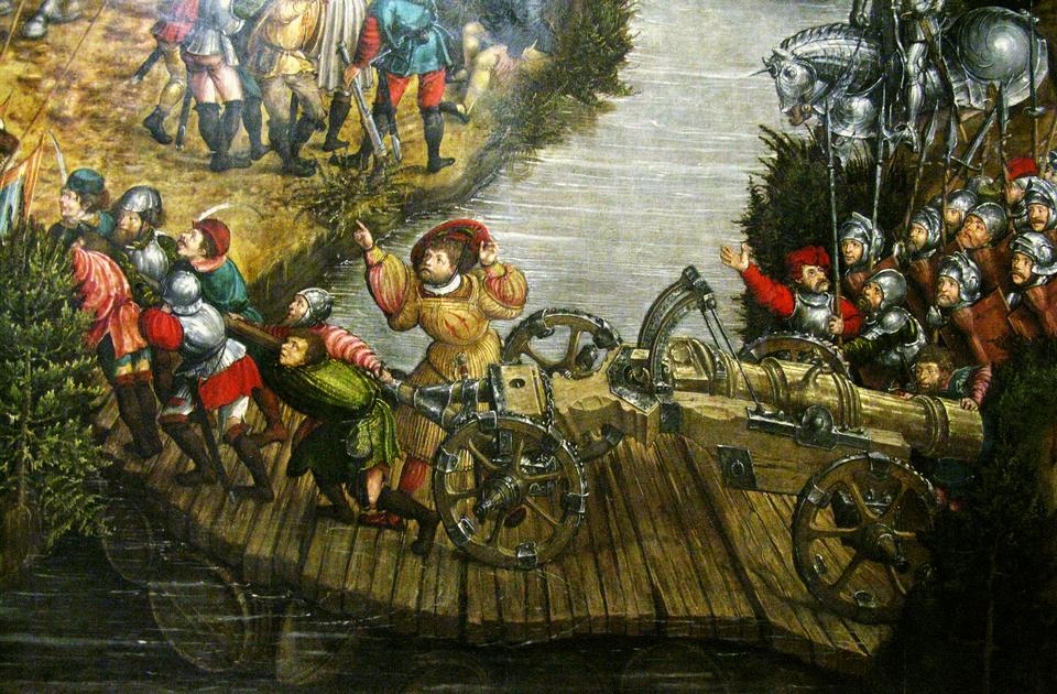 Bitwa pod Orszą - detal Przeprawa polskiej artylerii po improwizowanym moście pontonowym. Pod deskami można dostrzecłodzie ibeczki. Źródło: artysta nieznany, Bitwa pod Orszą - detal, między 1525-1540, tempera na dębowej desce, Muzeum Narodowe wWarszawie, domena publiczna.