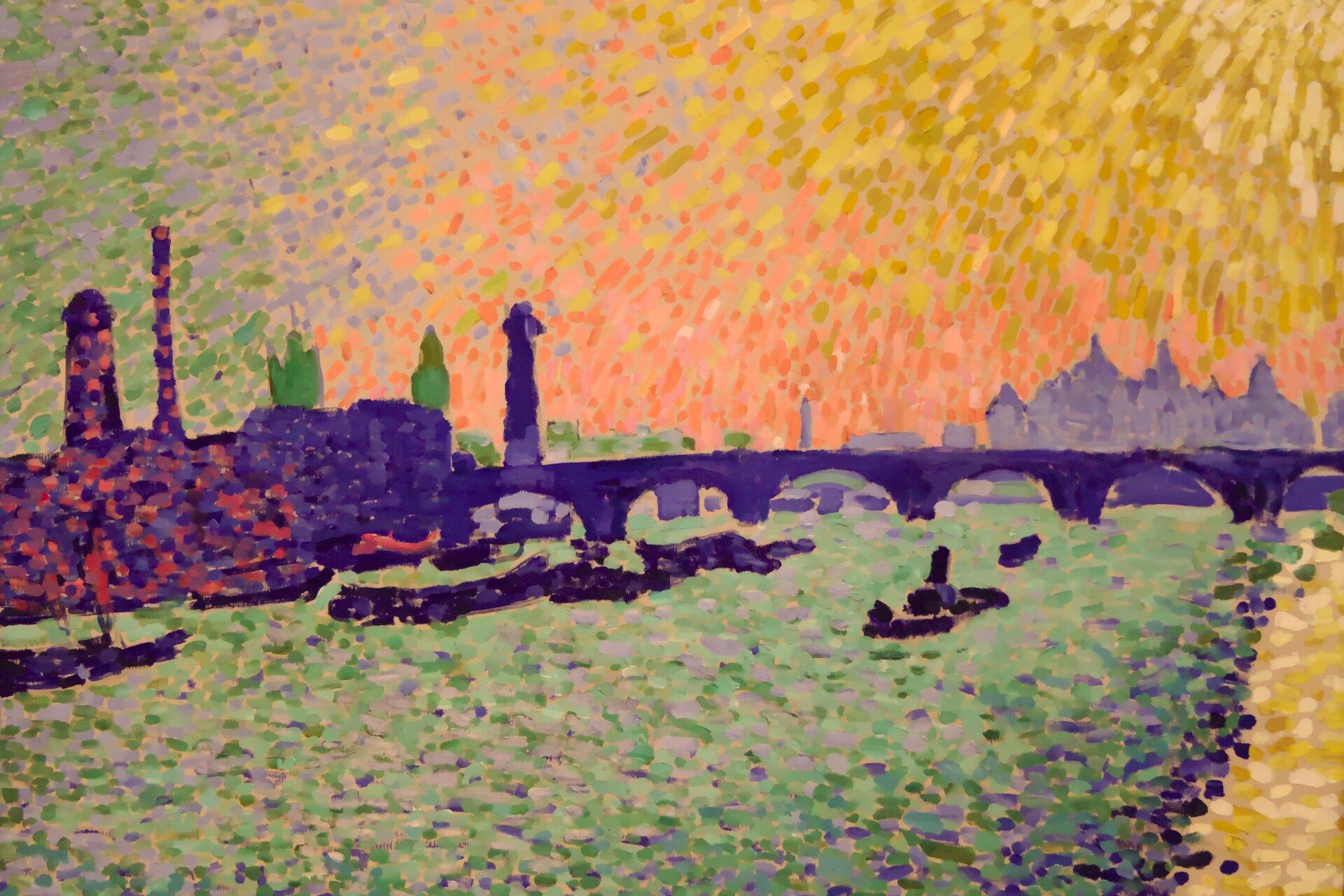 """Ilustracja przedstawia obraz André Deraina """"Most Waterloo"""". Dzieło ukazuje londyński krajobraz zTamizą imostem Waterloo, widzianymi znabrzeża Wiktorii. Na obrazie znajduje się także budynek parlamentu, przemysłowa zabudowa, barki oraz łodzie. Kolory użyte przez Deraina są całkowicie oderwane od naturalistycznego wyglądu. Na przykład ciemnozielona lokomotywa znajduje się na purpurowym moście pod łososiowo różowym niebem, podczas gdy rzeka faluje zakcentami jasnej zieleni, fioletu iszmaragdu. Kolory zostały nałożone techniką pointylistyczną czyli namalowane za pomocą naniesionych pędzlem punktów."""