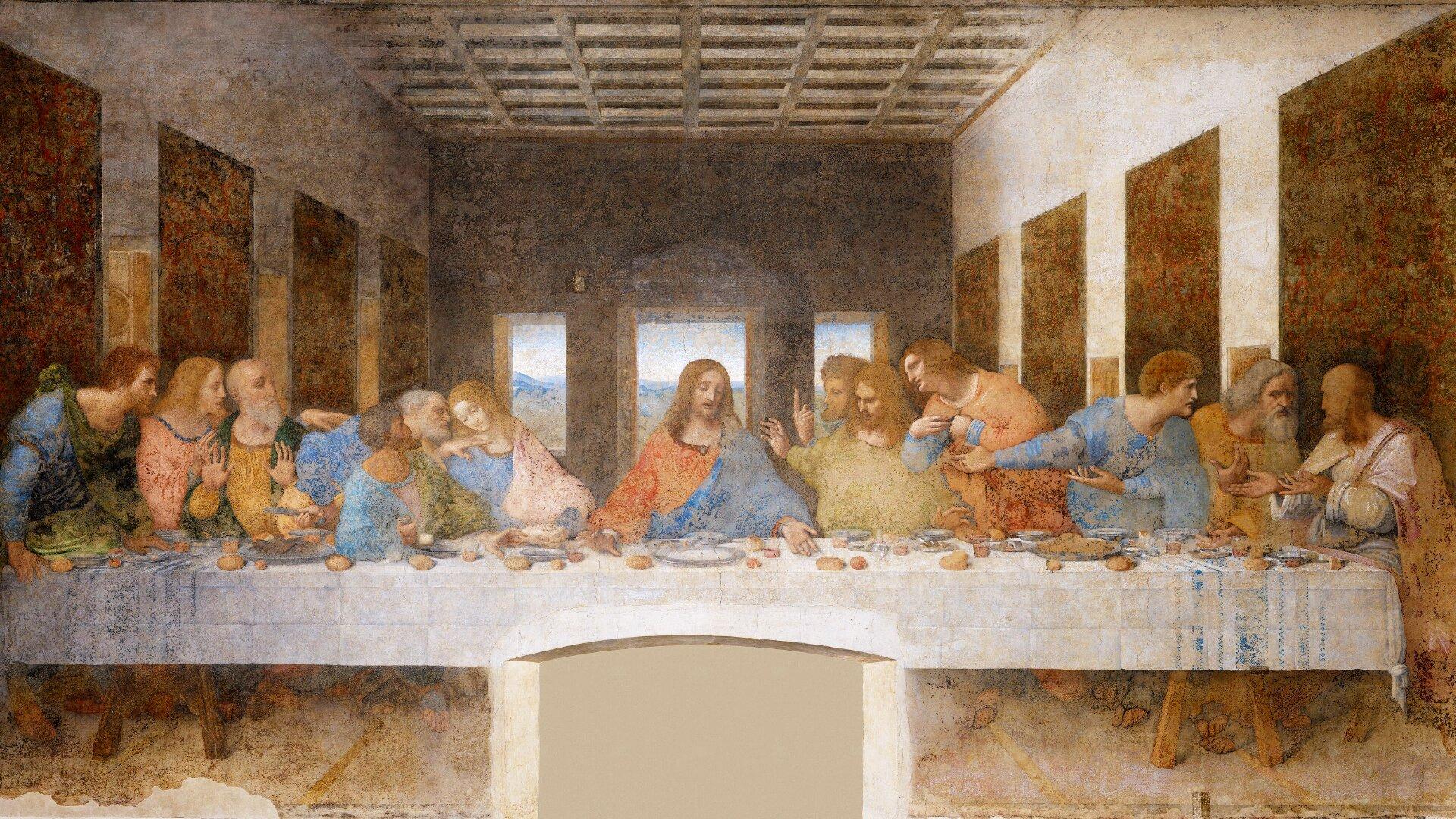 """Obraz pt. """"Ostatnia Wieczerza"""" przedstawia Chrystusa siedzącego pośrodku stołu. Po jego lewej iprawej stronie znajdują się apostołowie."""