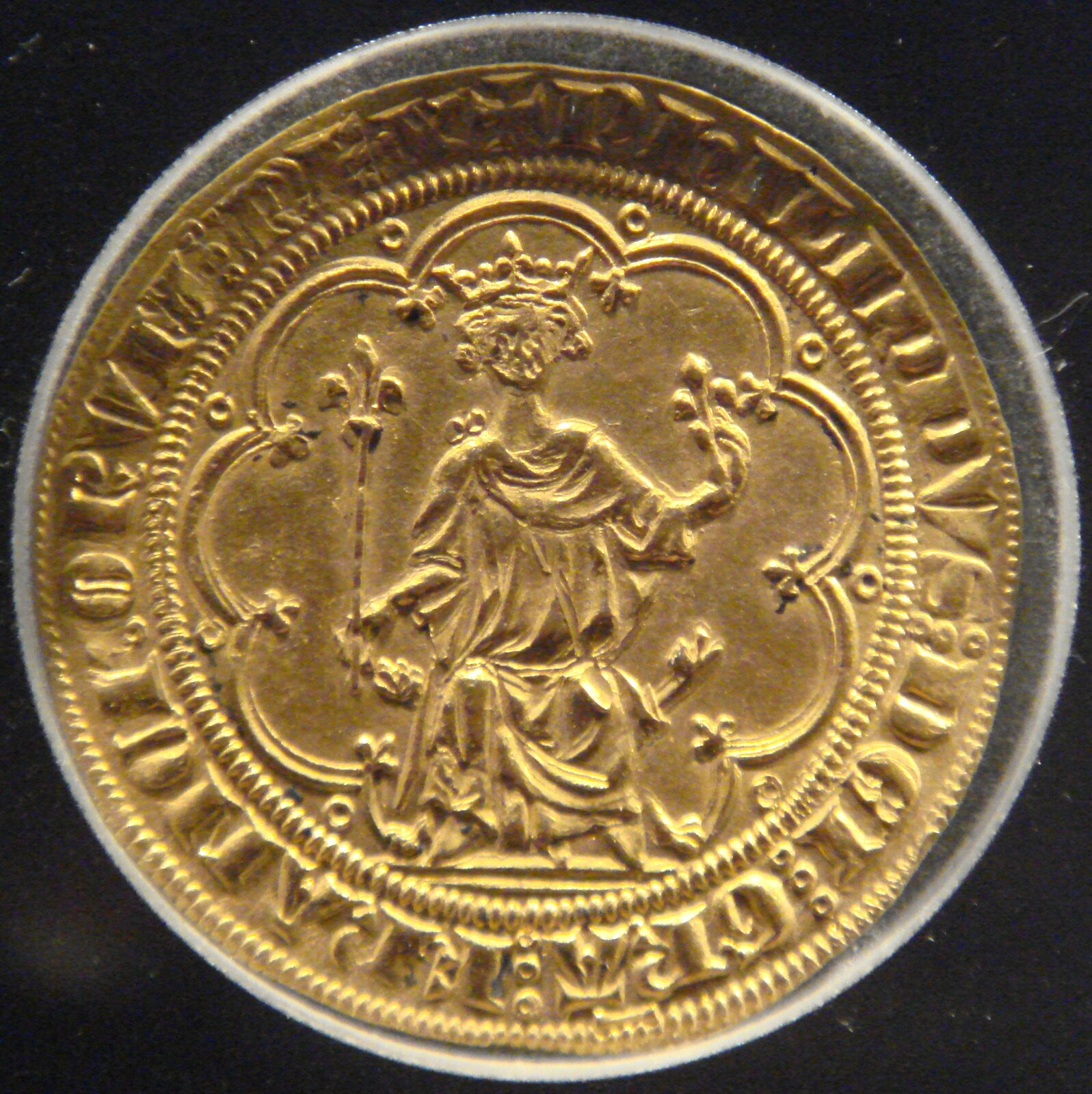 Moneta przedstawiająca Filipa IV Pięknego Źródło: PHGCOM, Moneta przedstawiająca Filipa IV Pięknego, licencja: CC BY-SA 3.0.