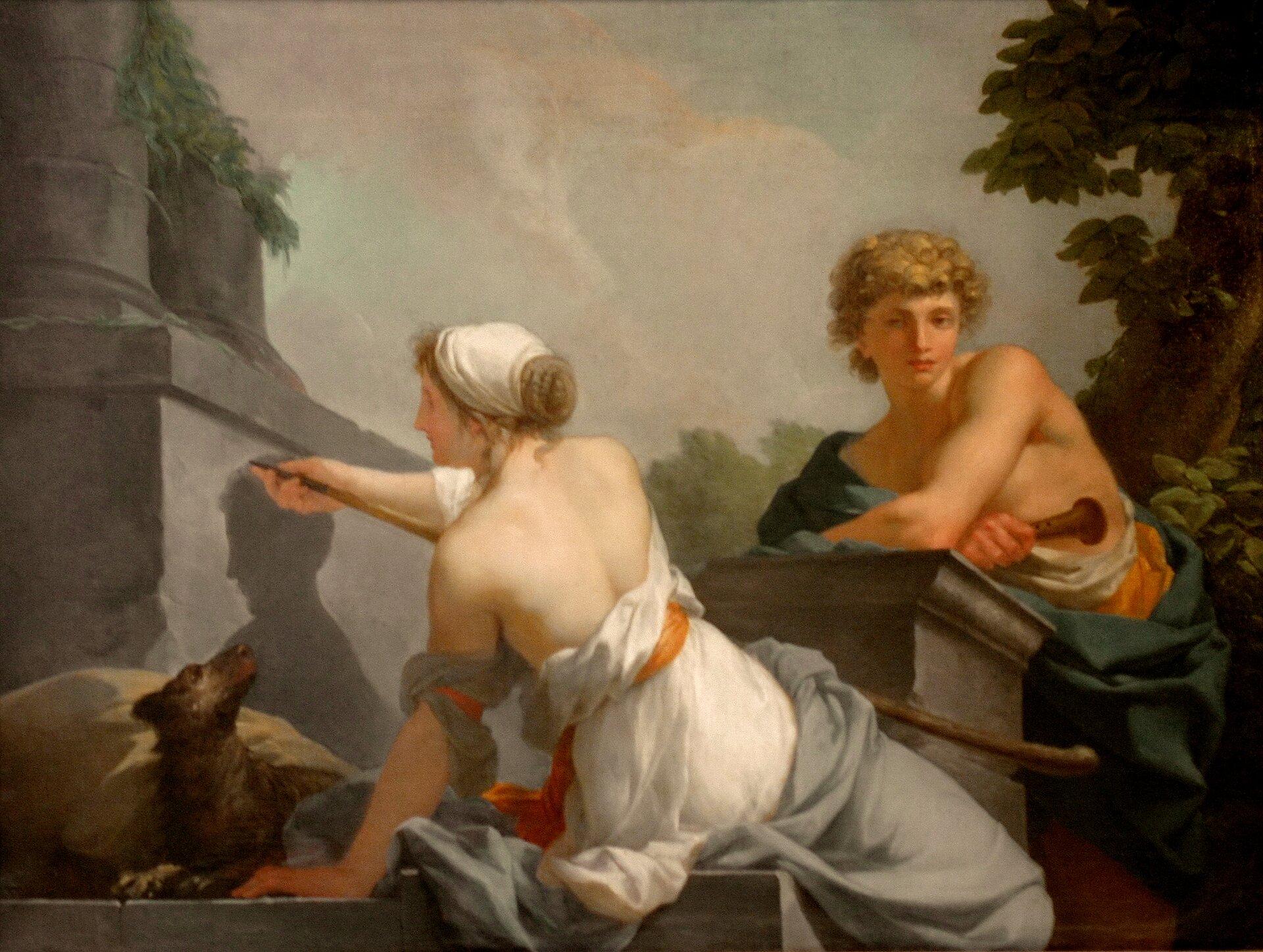 """Ilustracja przedstawiająca obraz Jeana Baptiste Regnaulta pt. """"Początki malarstwa"""". Obraz przedstawia młodych kobietę imężczyznę. Kobieta rysuje po kamiennej ścianie."""